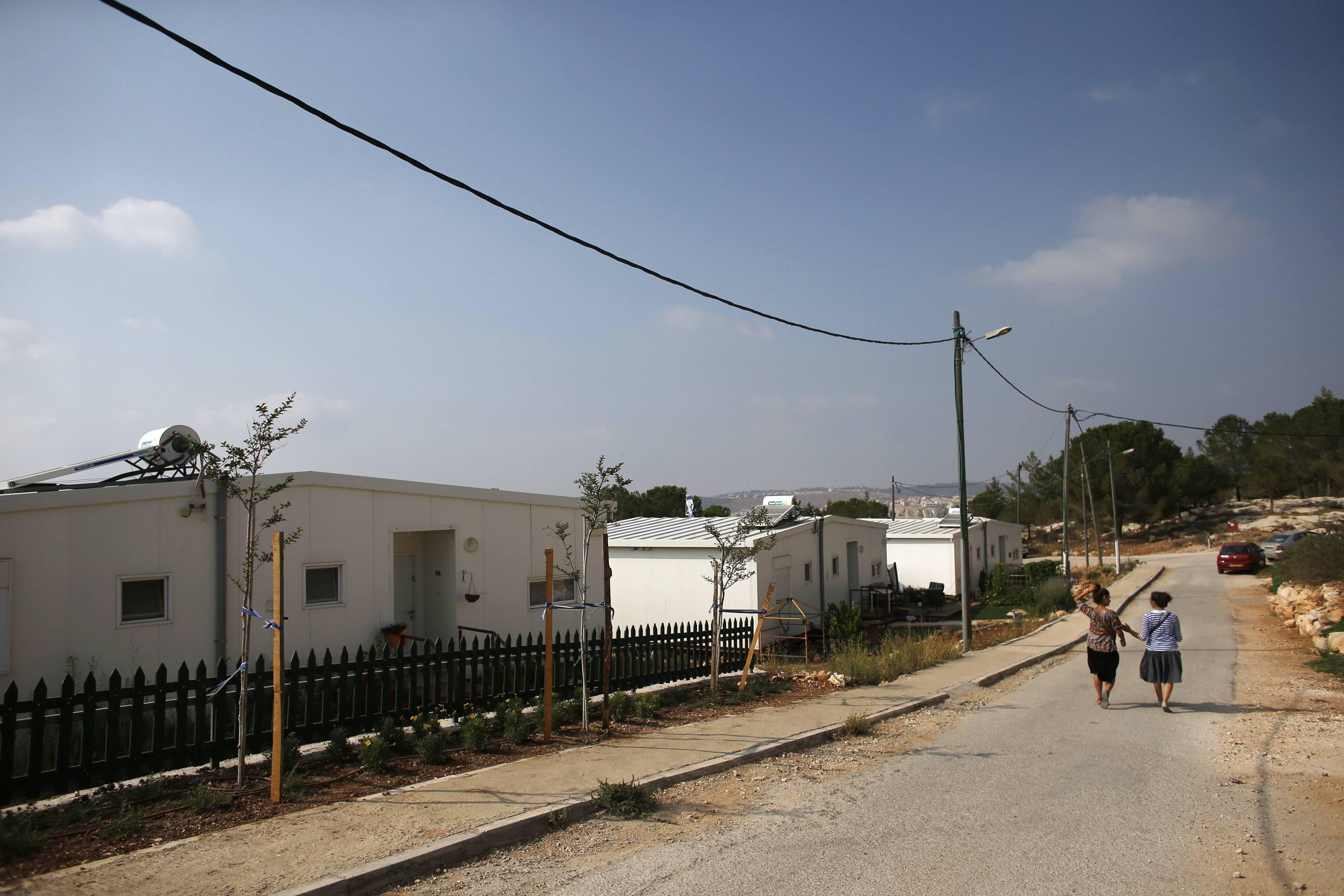 Image: Israeli women walk in a Jewish settlement known as