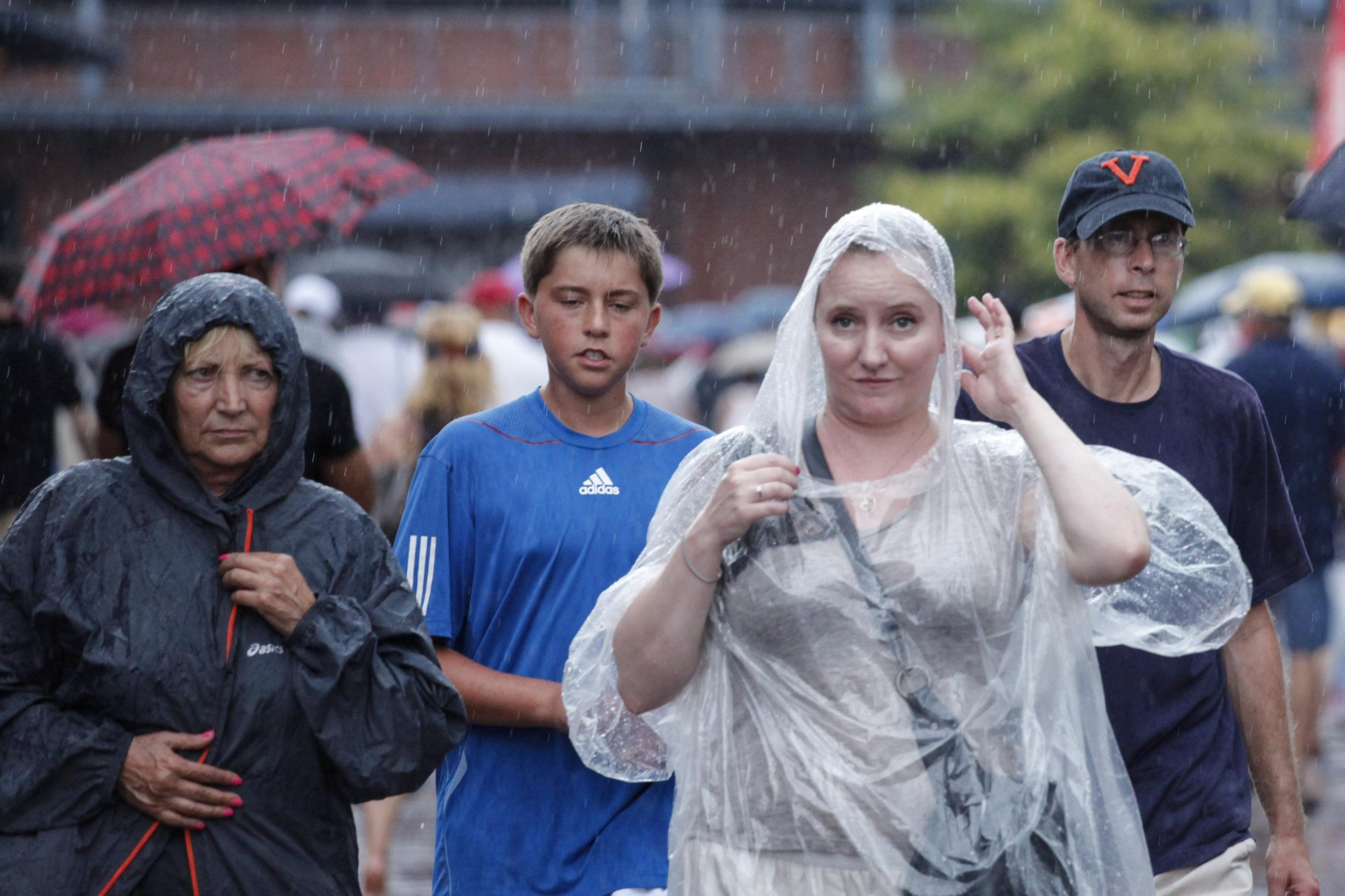 Image: U.S. Open fans get drenched