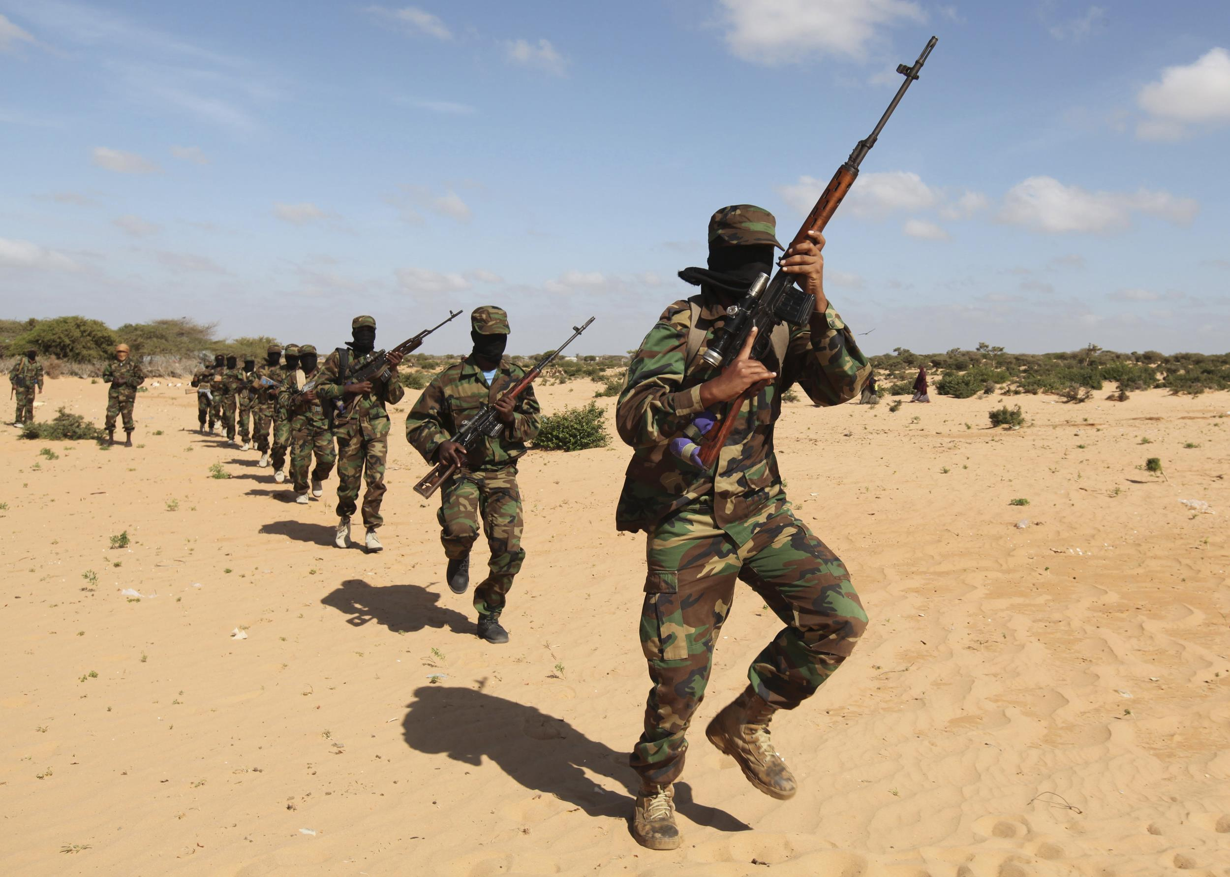 Members of Somalia's Al Shabaab militant group parade during a demonstration