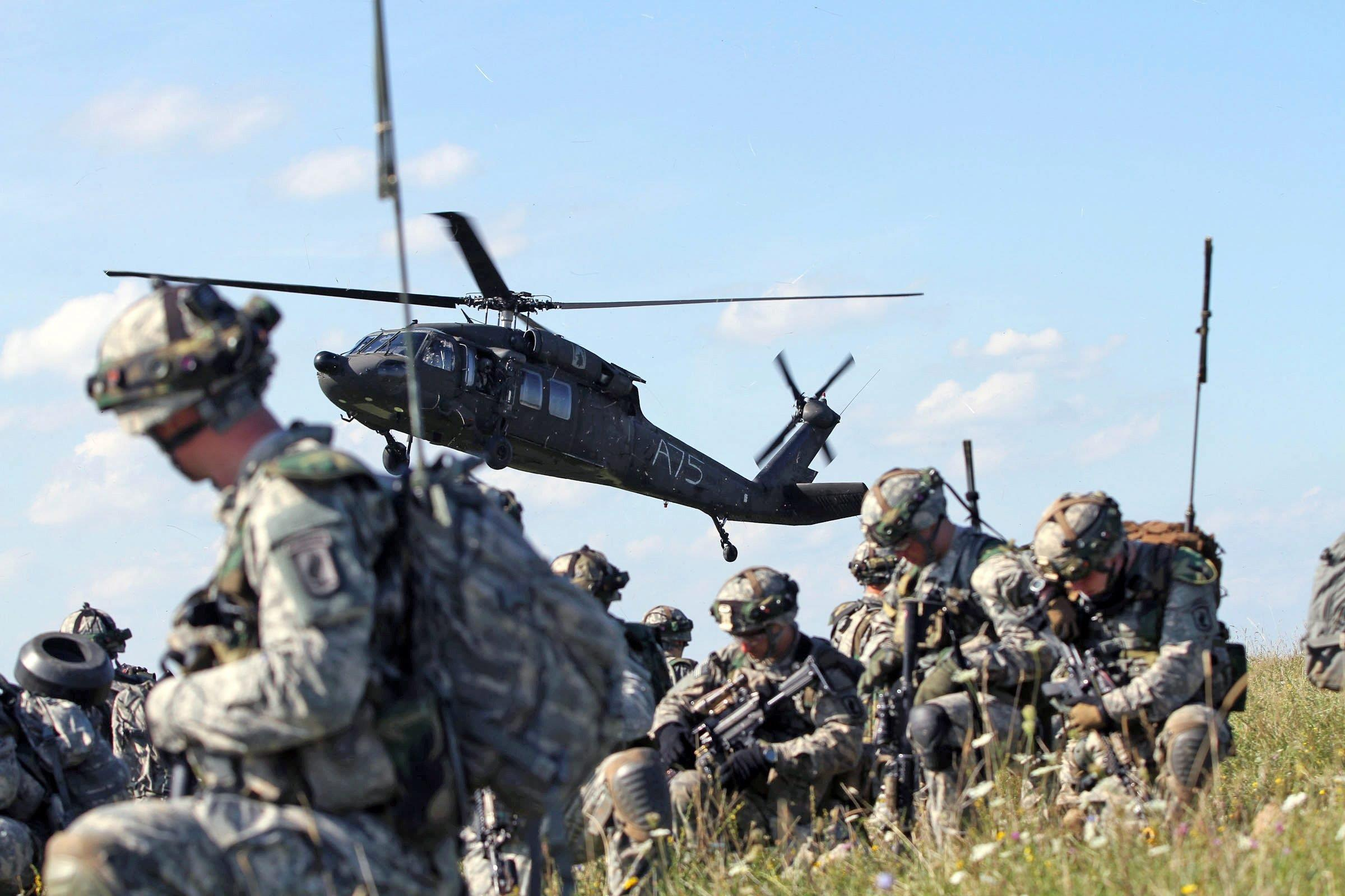 Image: 173rd Airborne Brigade paratroopers air assault through mock village during Saber Junction 14