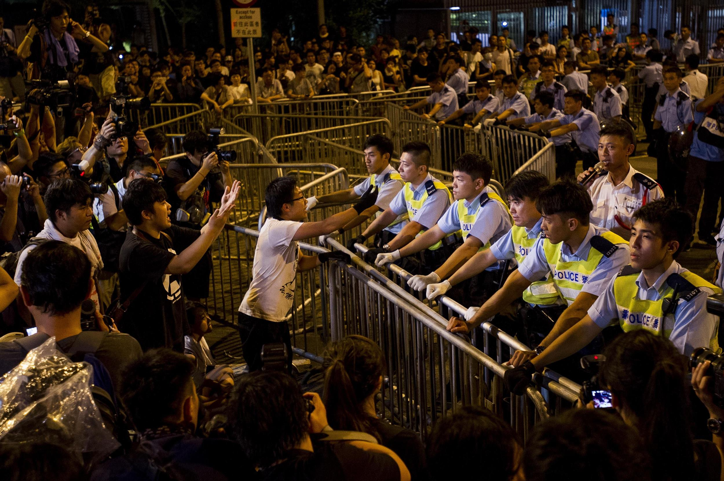China Turns Screw on Hong Kong's 'Umbrella Revolution'