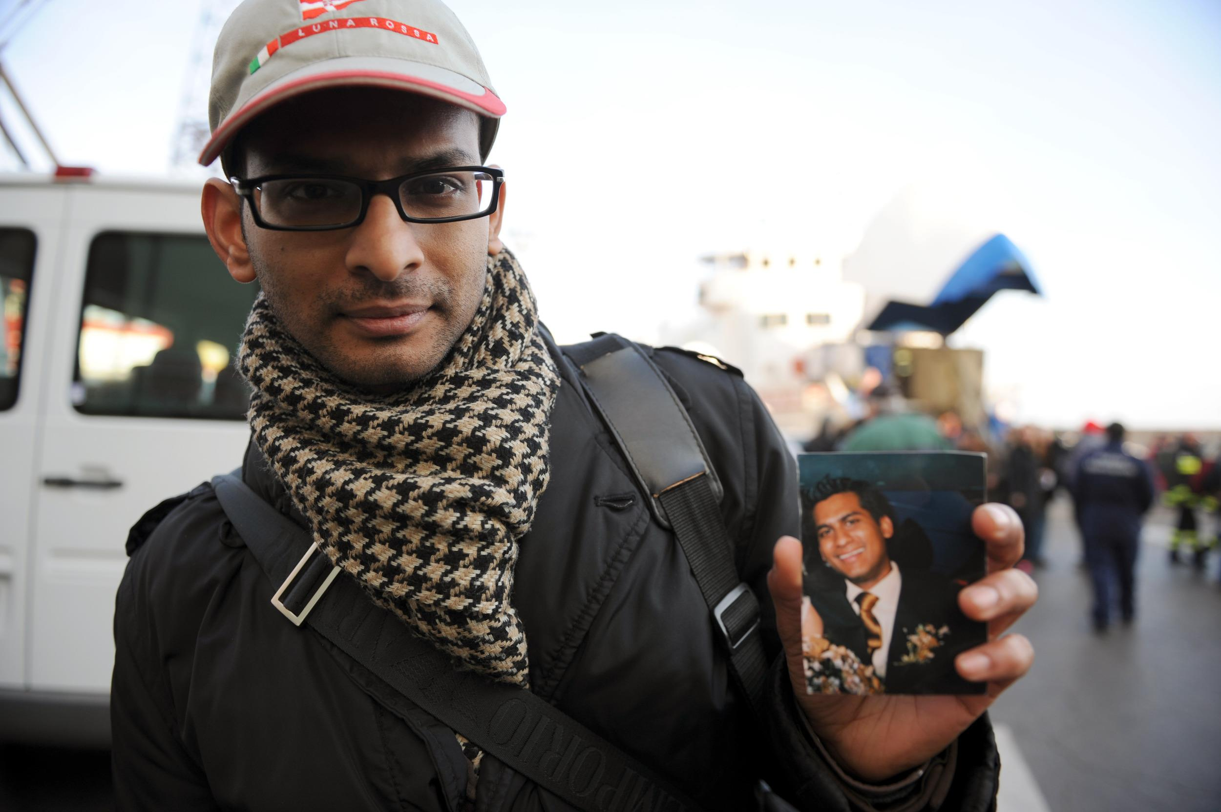 Image: Indian Kevin Rebello shows a picture of