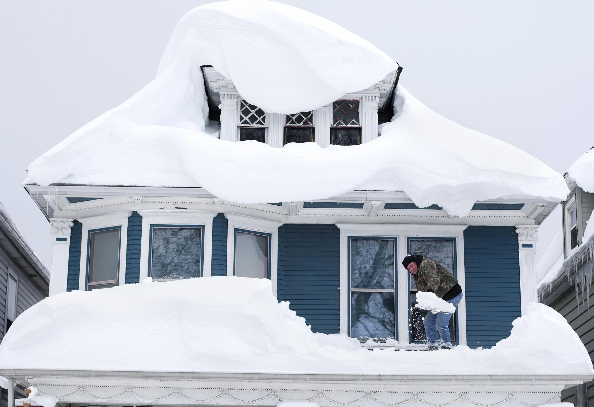 buffalo digs out from snow as flooding  roof collapse
