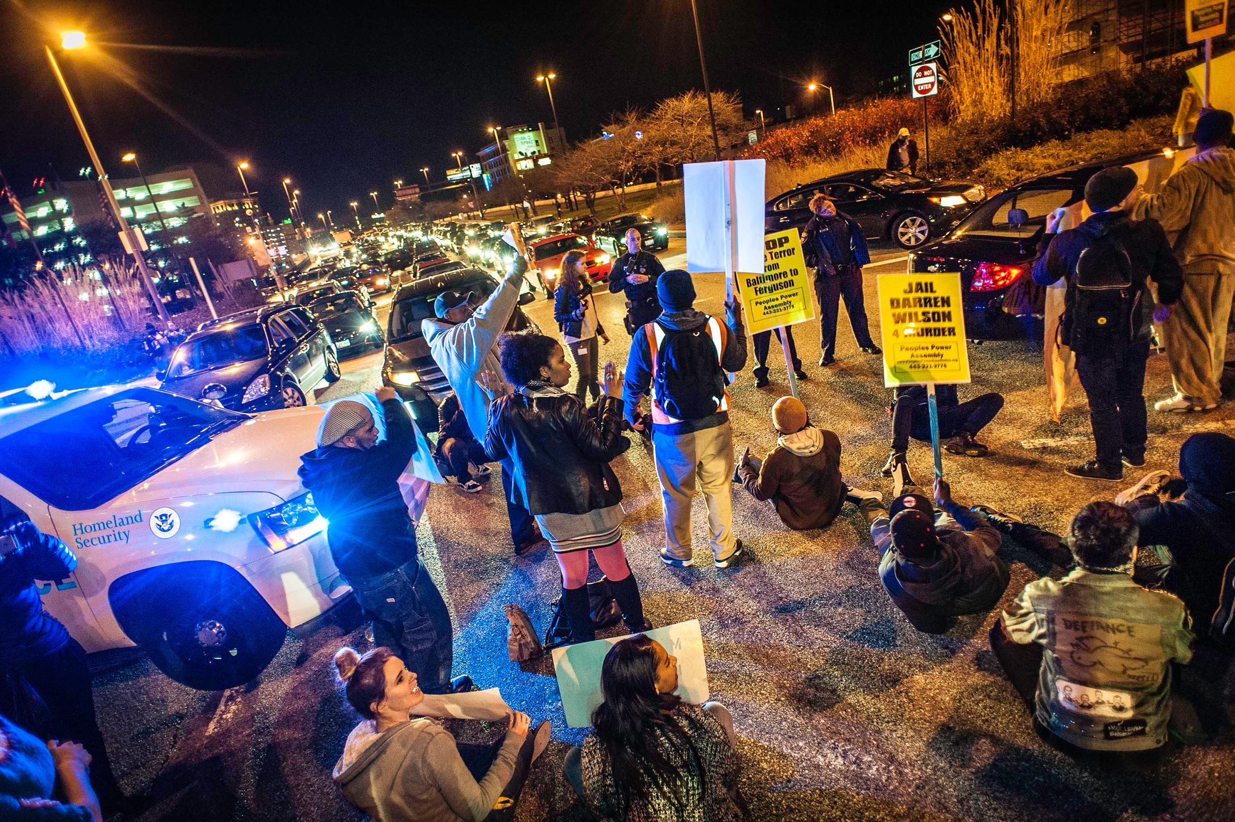 Image: Protesters came out en masse for peaceful demonstrations as they blocked traffic on the Jones Falls Expressway, one of the main arteries out of downtown in Baltimore