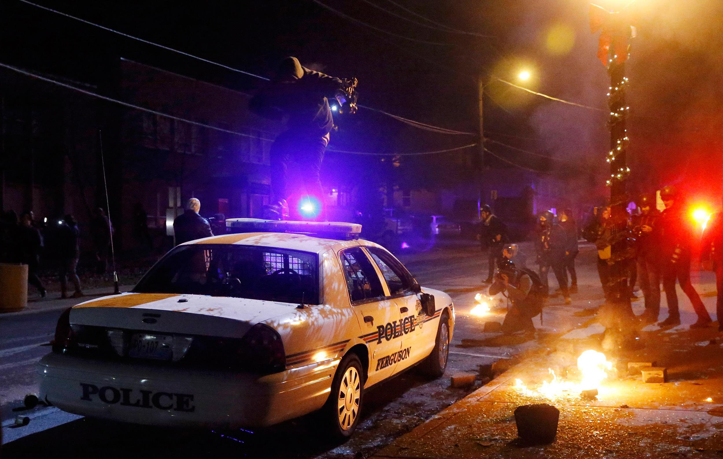 Flare-Up: Protesters and Police in Tense Showdown in Ferguson
