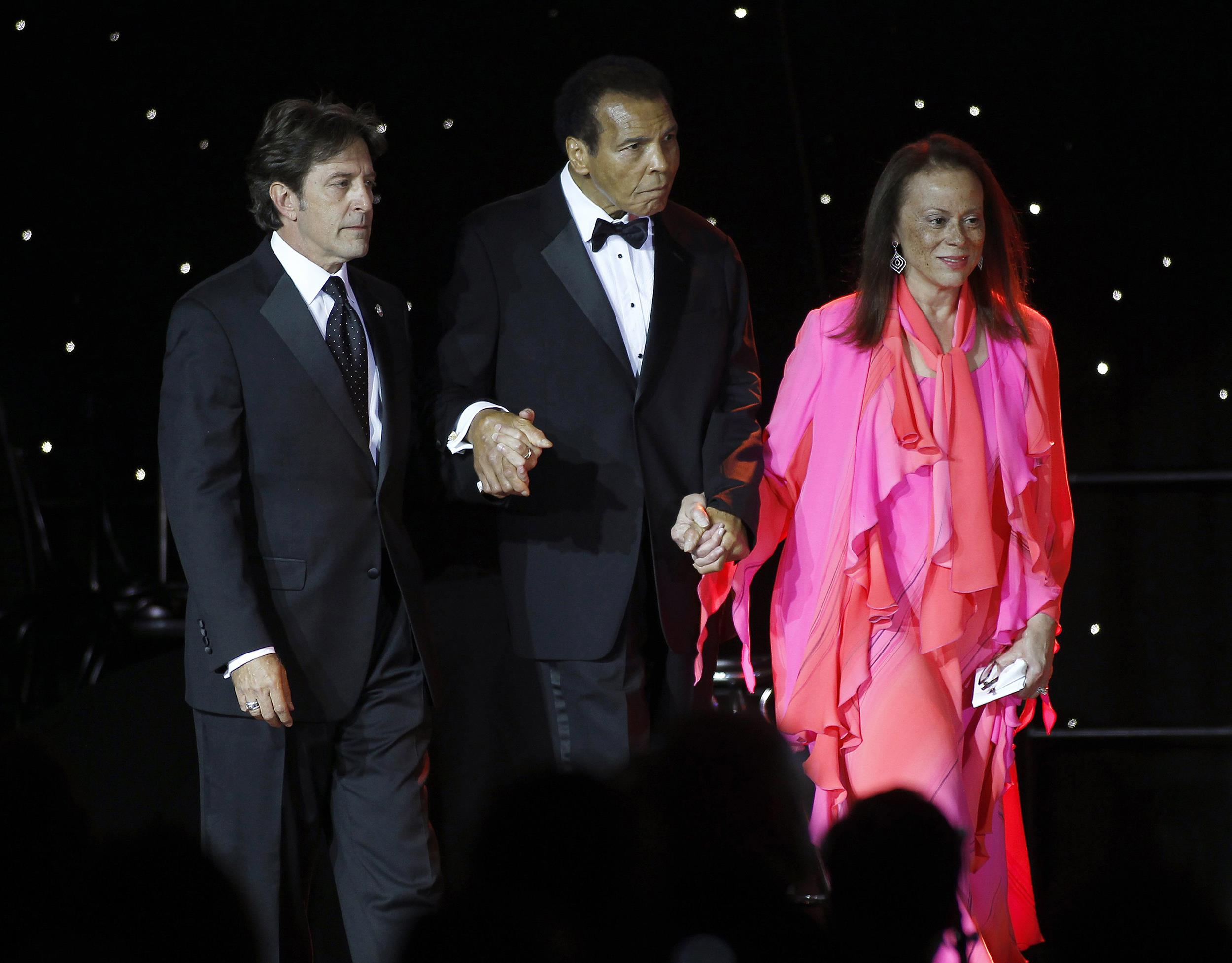 Image: Muhammed Ali is escorted on stage by his wife Lonnie Ali and a personal assistant during The Muhammad Ali Celebrity Fight Night Awards XIX in Phoenix