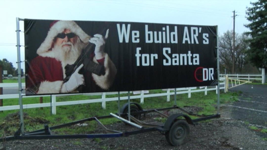 http://media2.s-nbcnews.com/i/newscms/2014_51/818146/141221-santa-gun-billboard-120p_487c24cdf5a1b98b7a1f9c30e2158af9.jpg