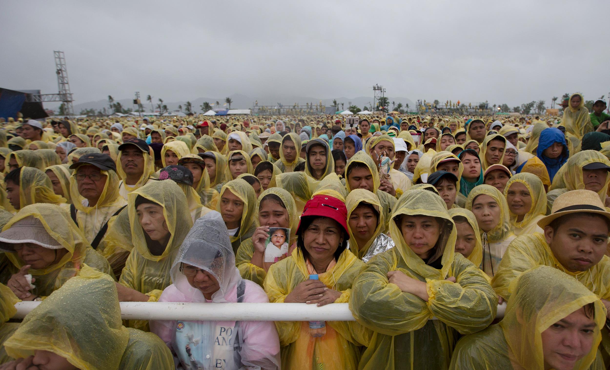 Truly saddened rain soaked pope comforts typhoon haiyan survivors