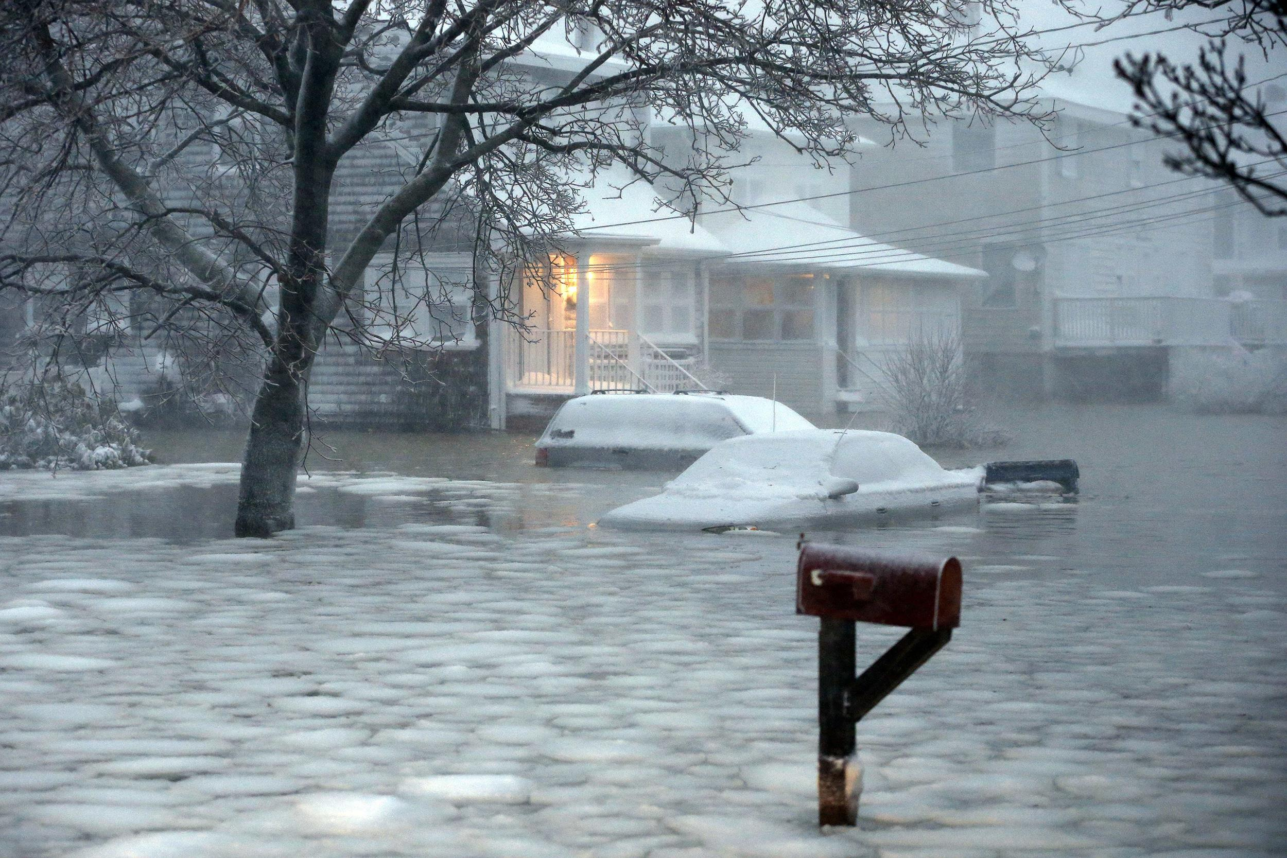 Image: Water floods a street on the coast in Scituate, Mass., Tuesday, Jan. 27