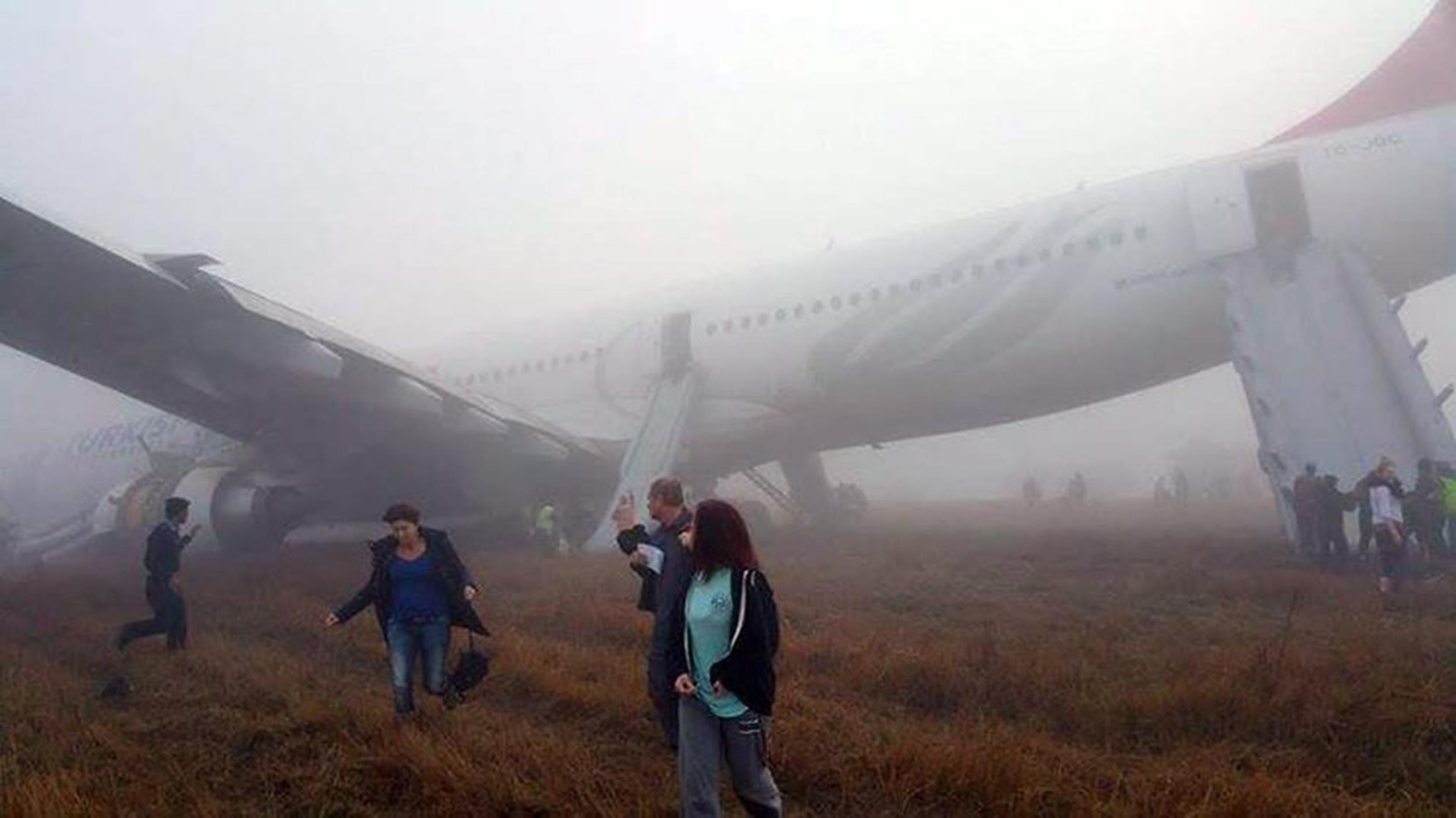 Passenger Jet Skids Off Runway After Foggy Landing