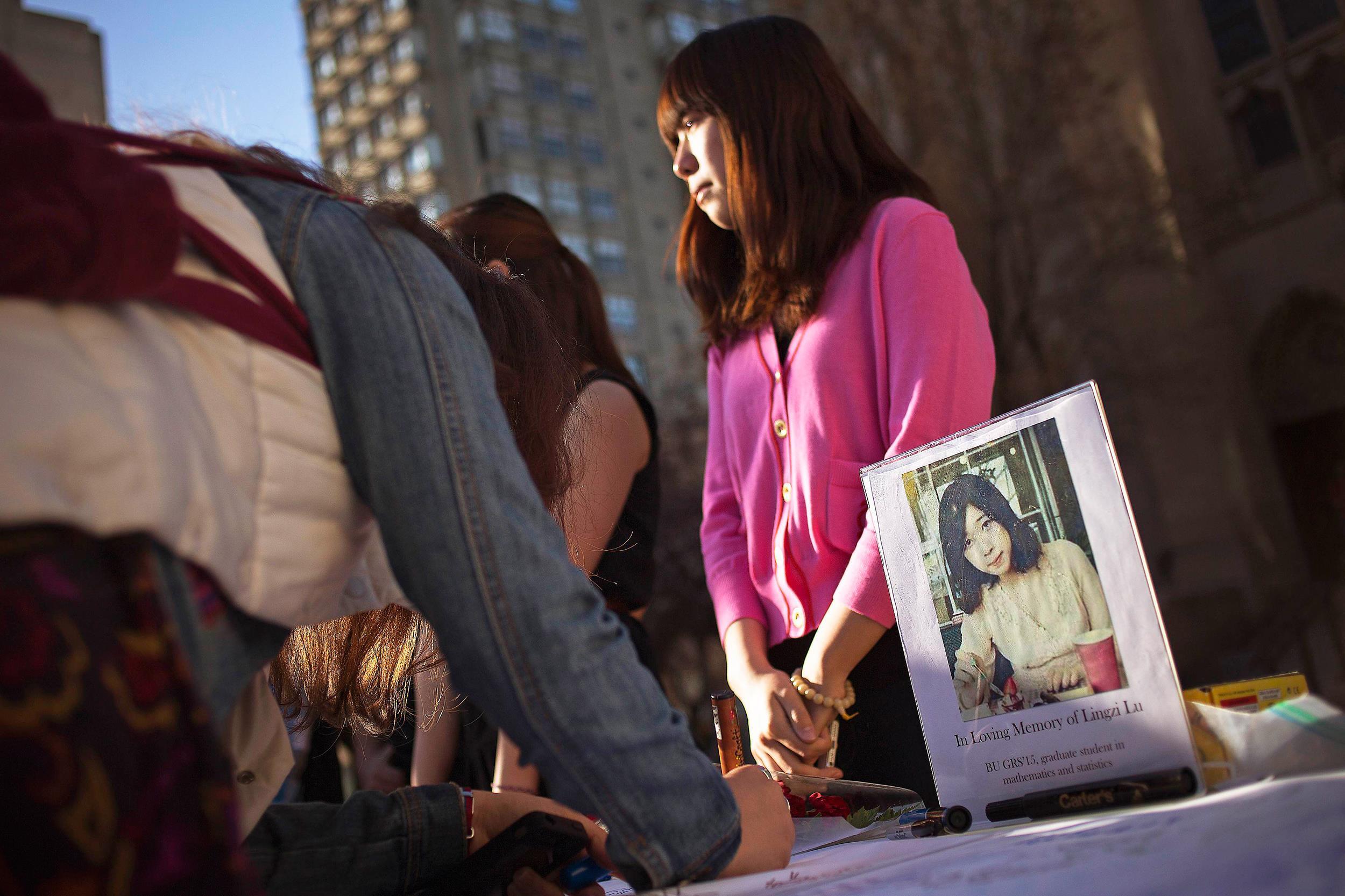 Image: A photo of Boston Marathon bombing victim Lu is seen outside the Boston University Marsh Chapel in Massachusetts