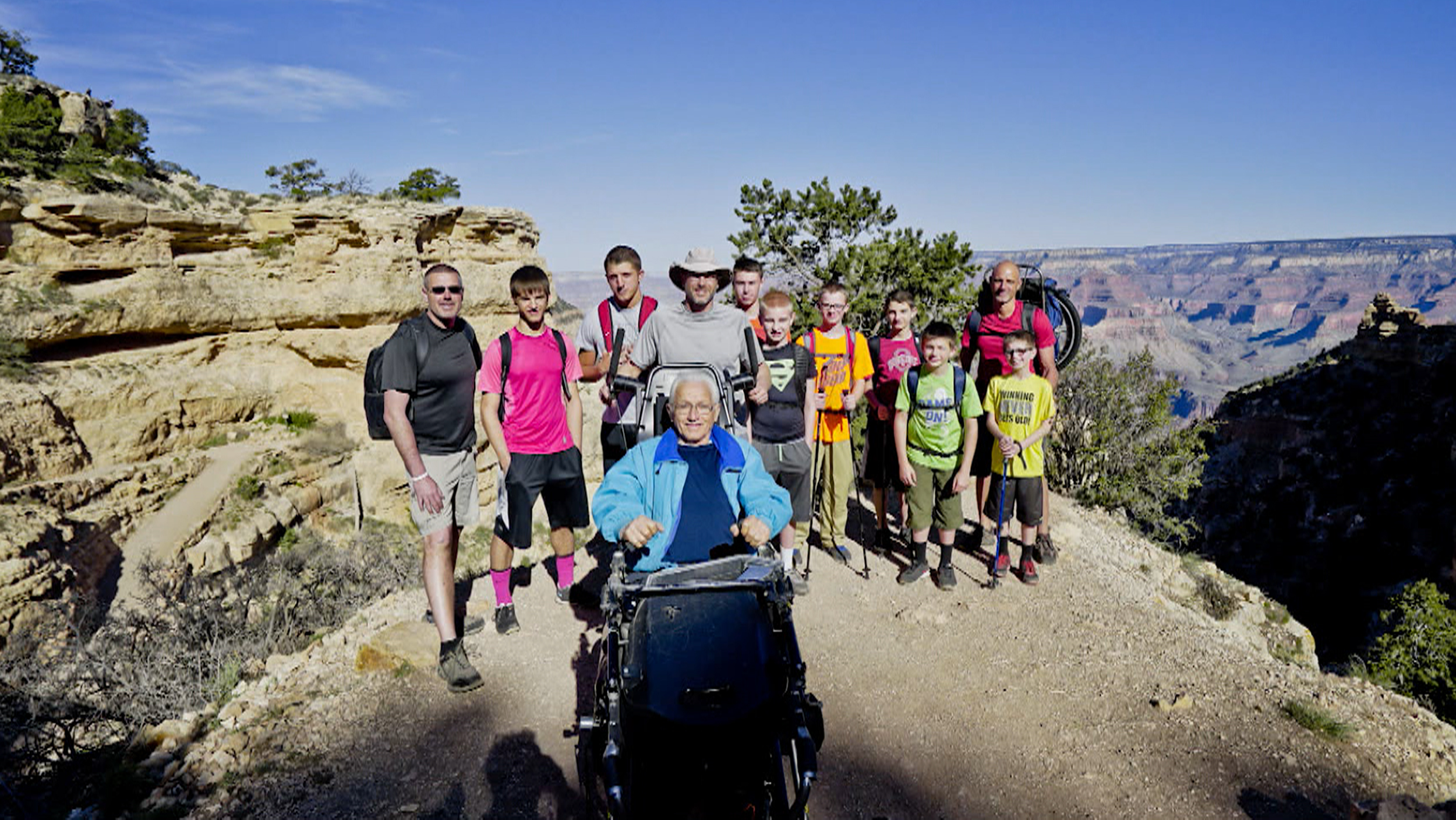Paralyzed Man Hikes Grand Canyon With Help Of Sons
