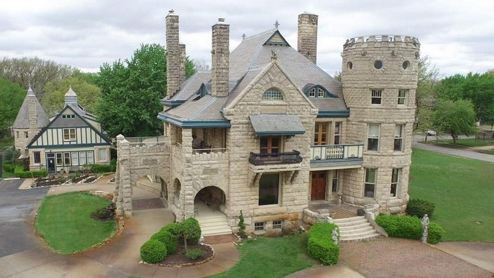 Forget mcmansions or tiny homes 5 u s castles for sale for Castle style house plans