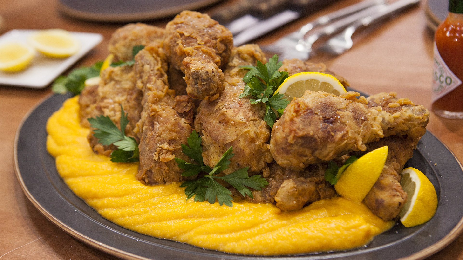 You can make Thomas Keller's Ad Hoc fried chicken at home. Lemon-brined for 12 hours and seasoned with herbs this is super juicy and perfectly crispy fried chicken. Although it takes time to prepare, it's totally worth it.