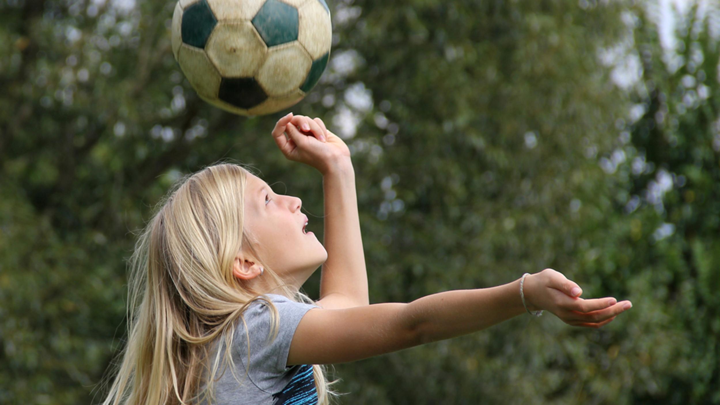 how to teach heading a soccer ball