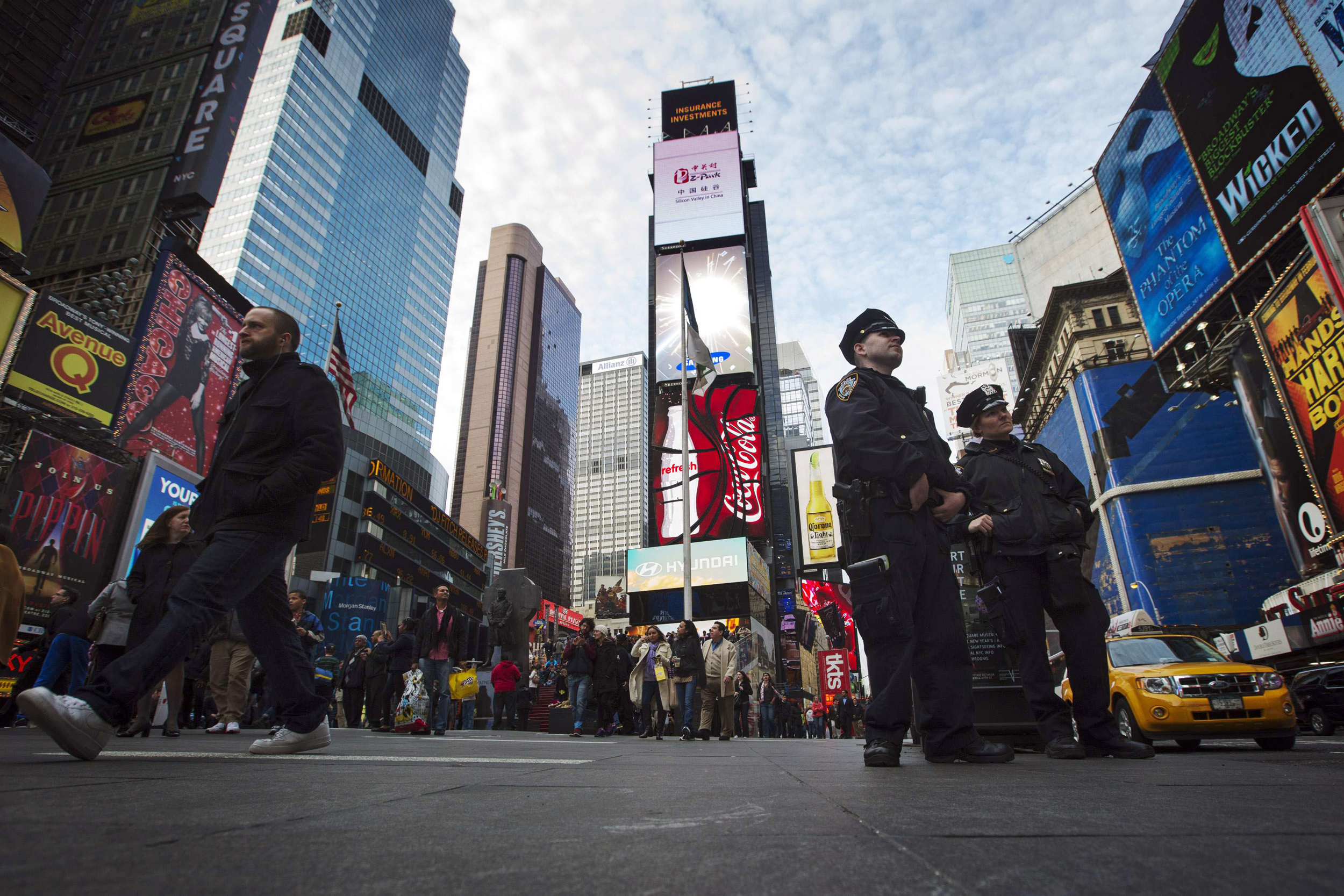 Image: NNew York Police Department officers stand in the Times Square district of New York during an increase in security