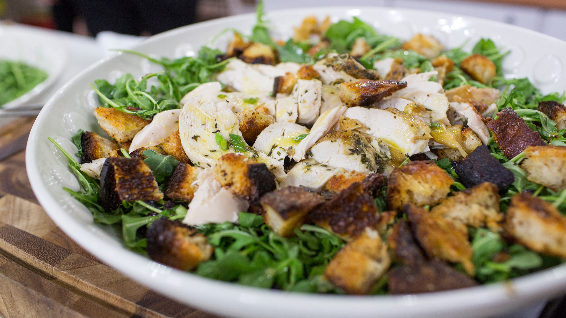 roast chicken over bread and arugula salad - today
