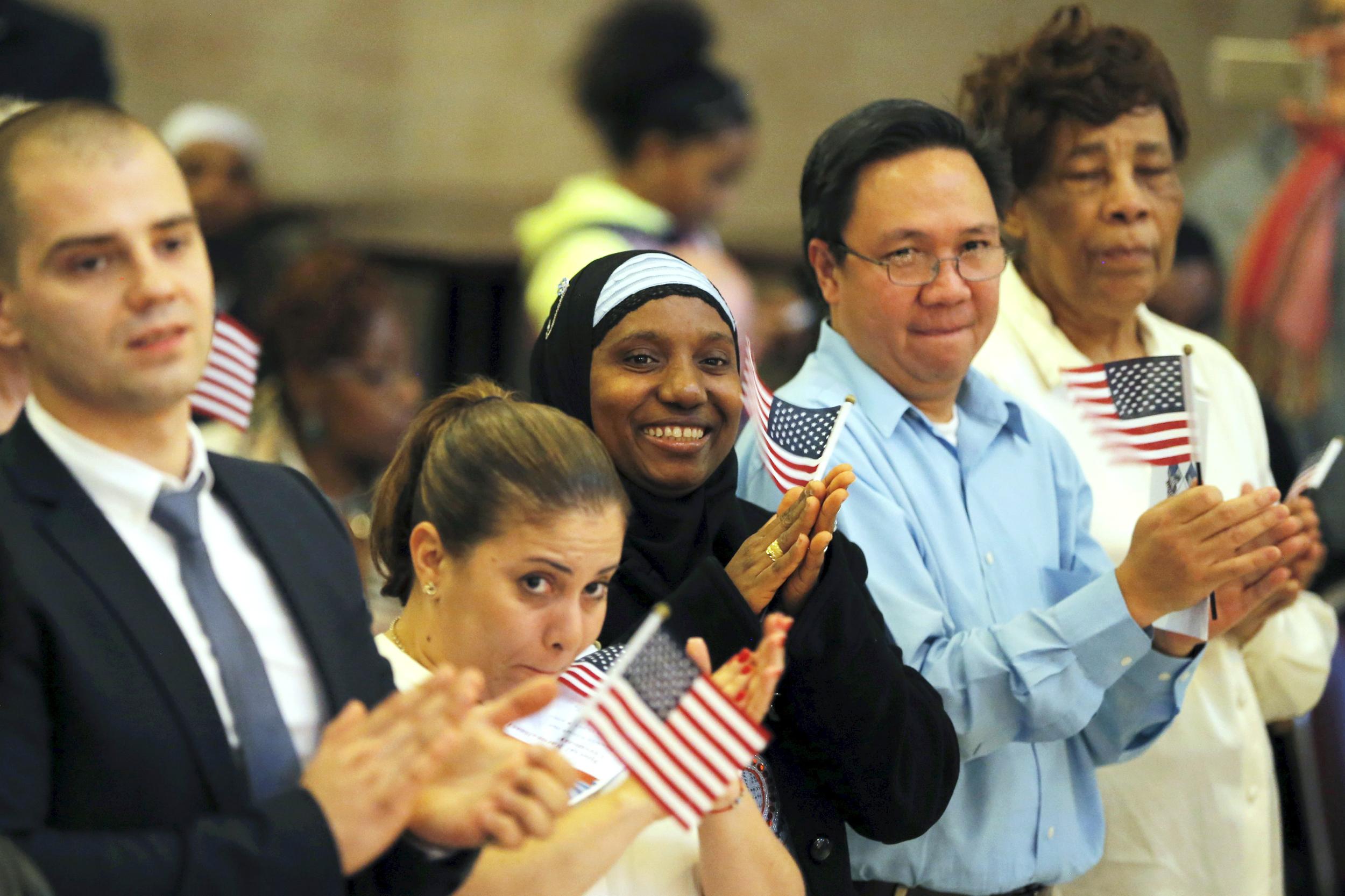 New Citizens Sworn in at Emotional Naturalization Ceremonies