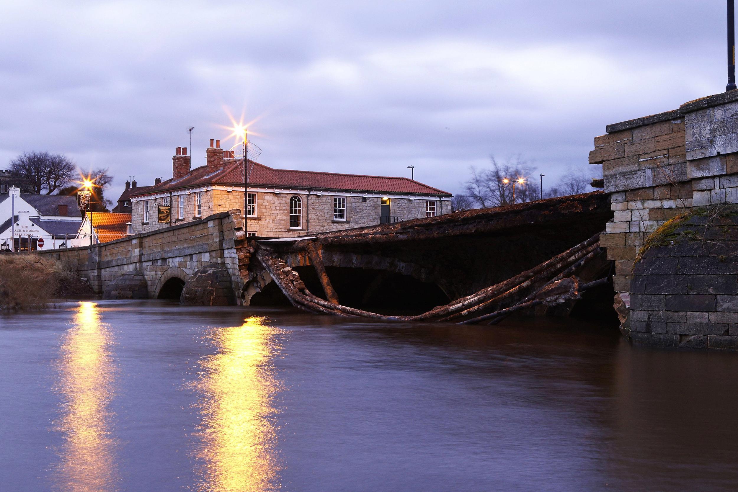 Raging Floodwaters Destroy Historic British Bridge