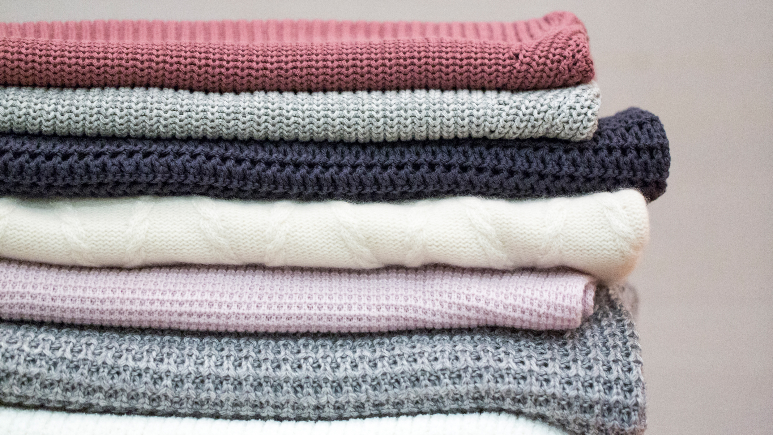 400728b6ec796 How to fold chunky sweaters so they stay perfectly stacked