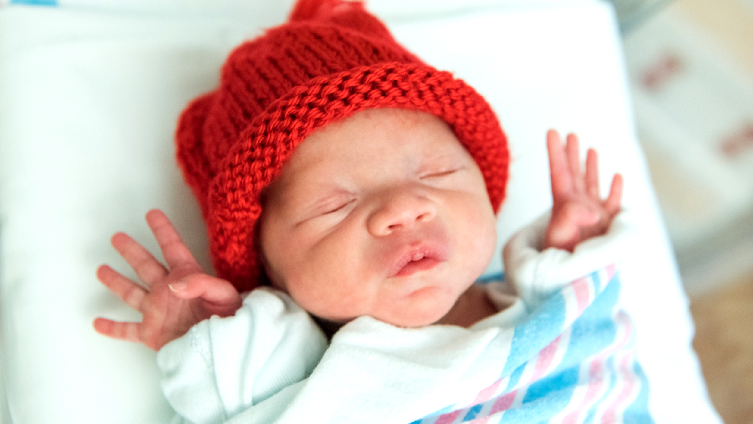 Babies in tiny red caps help raise awareness for heart disease in February 55dd8b5ba