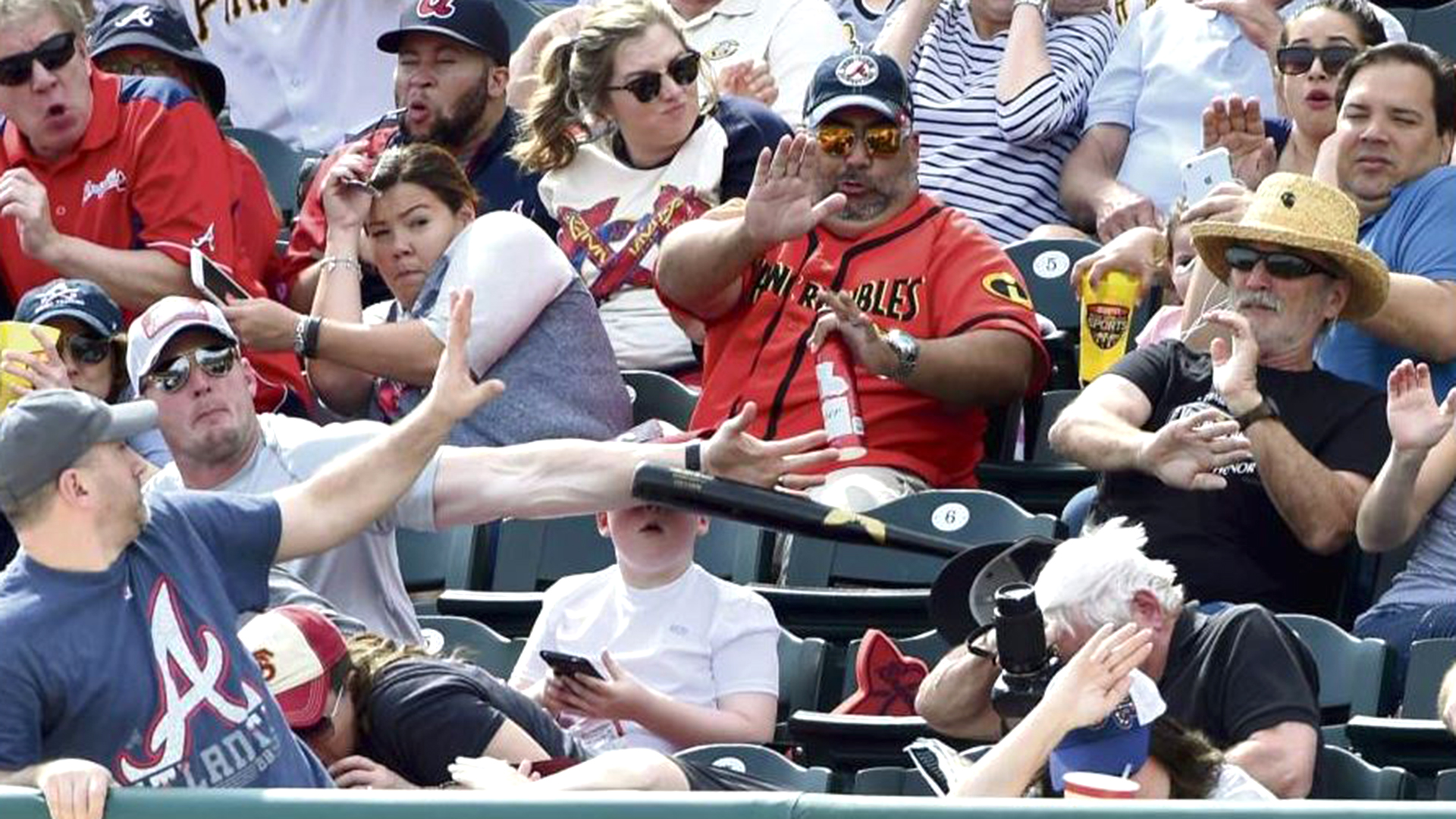 Fan saves boy from getting smacked in the face with baseball bat: See the  moment