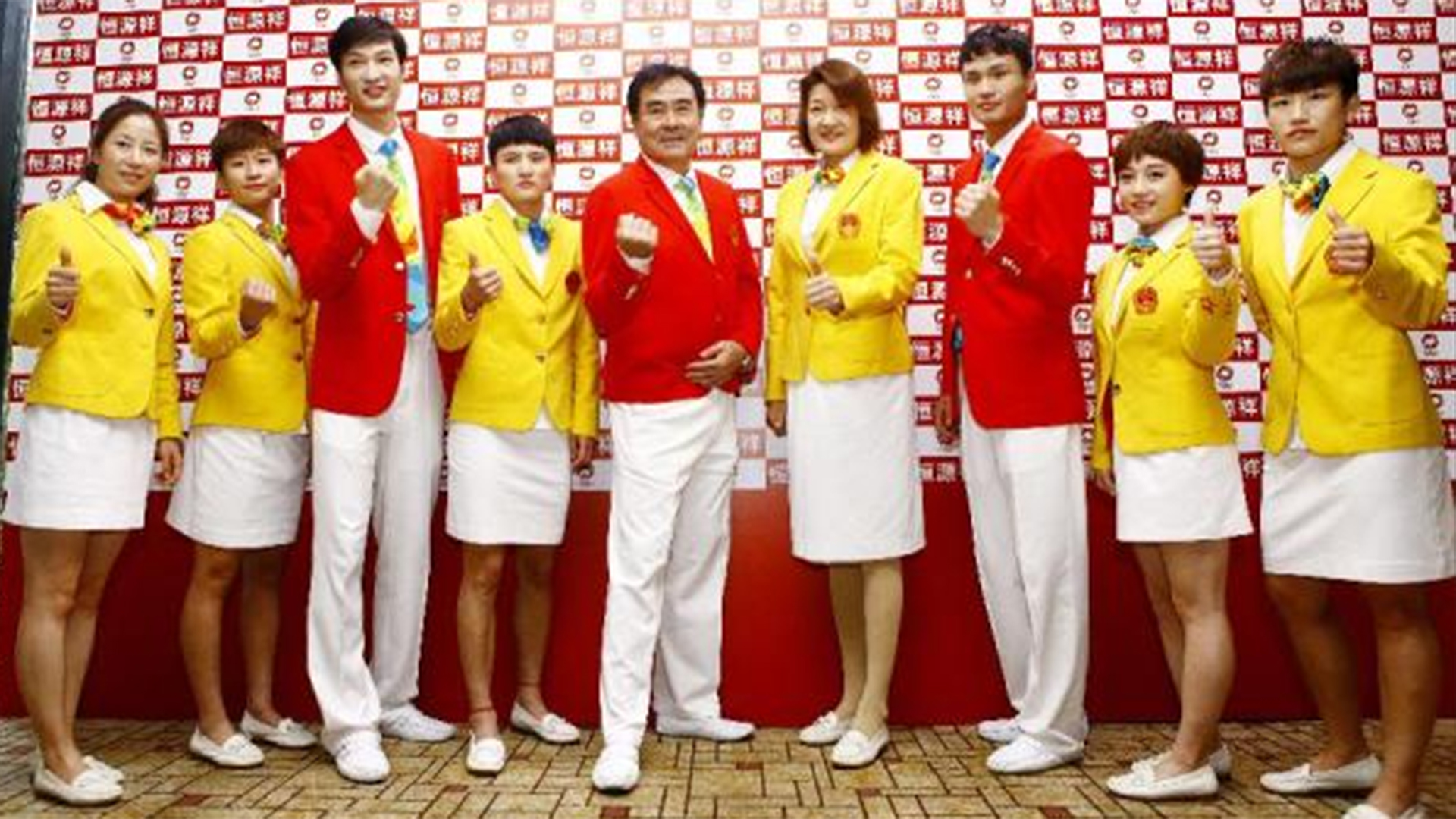 e6a5091d80e09 These Chinese Olympic uniforms have people seeing red (and  fried egg   yellow)