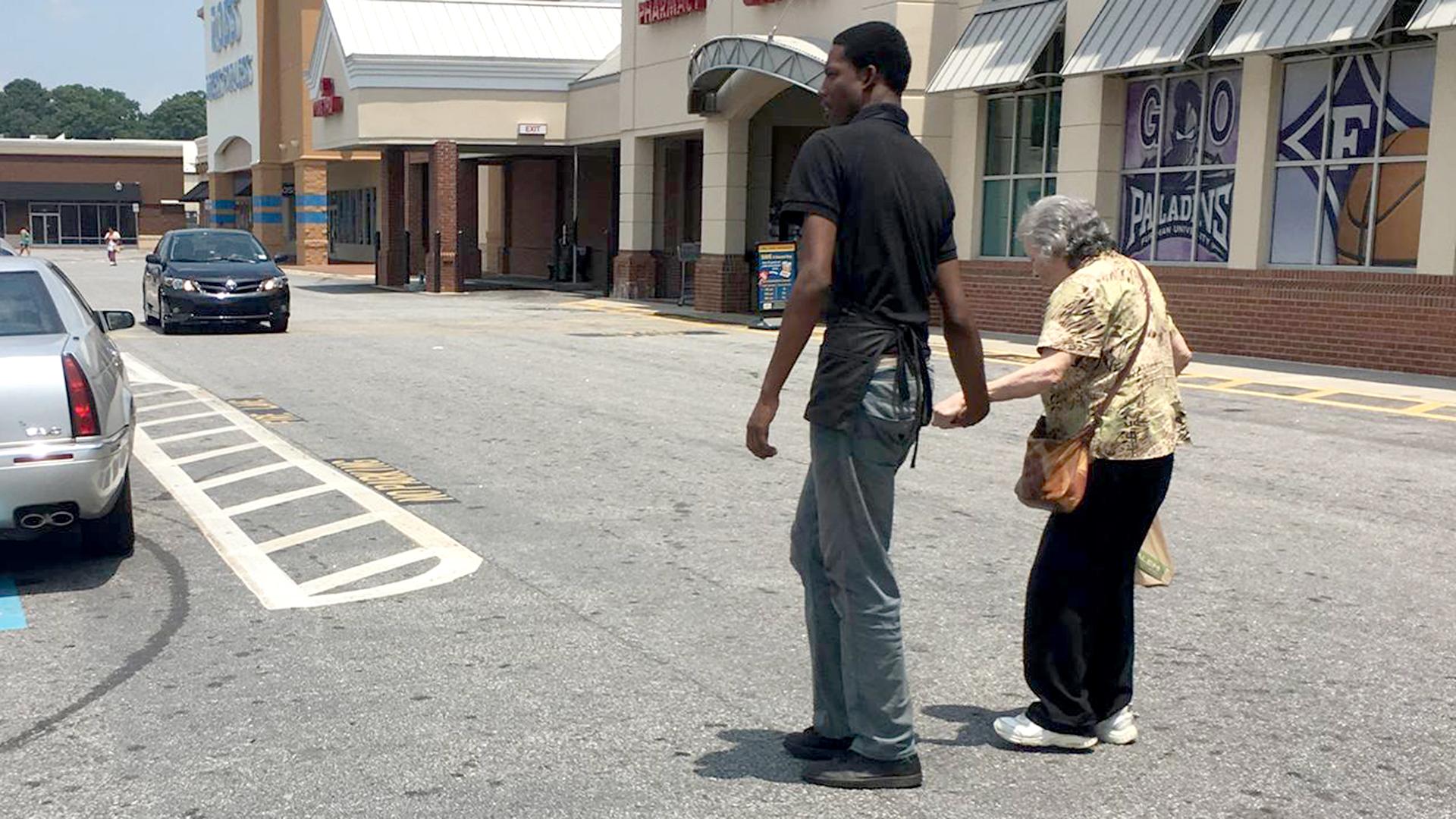 Grocery Store Worker Helps Elderly Woman Walk Across