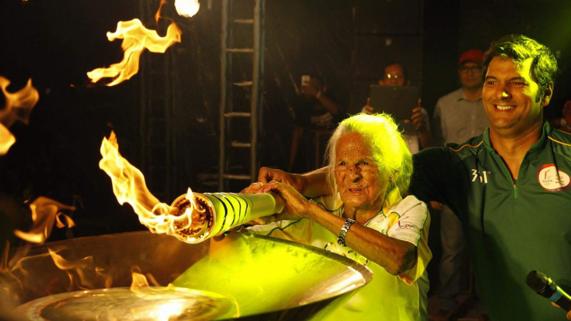 106-year-old torchbearer lights Olympic cauldron in Brazil ...