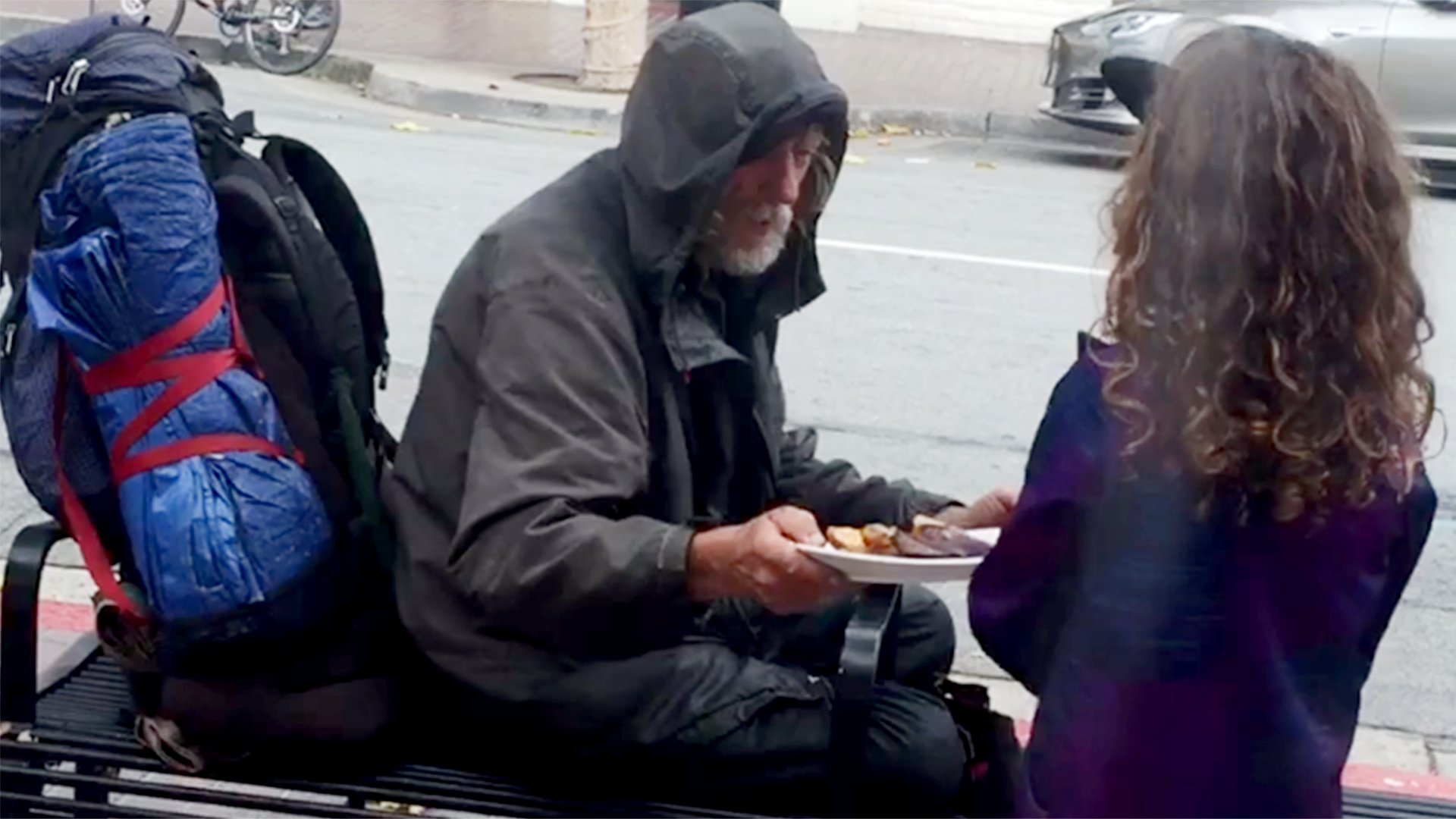 8 year old girl gives her meal to homeless man and