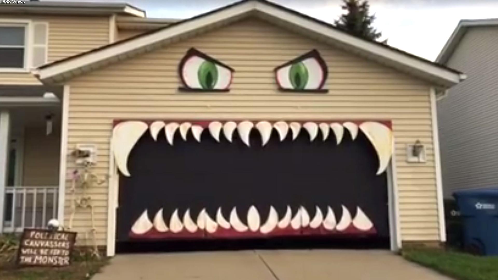 Halloween garage door decorations - People Can T Stop Watching This Halloween Monster Garage Go Up And Down Today Com
