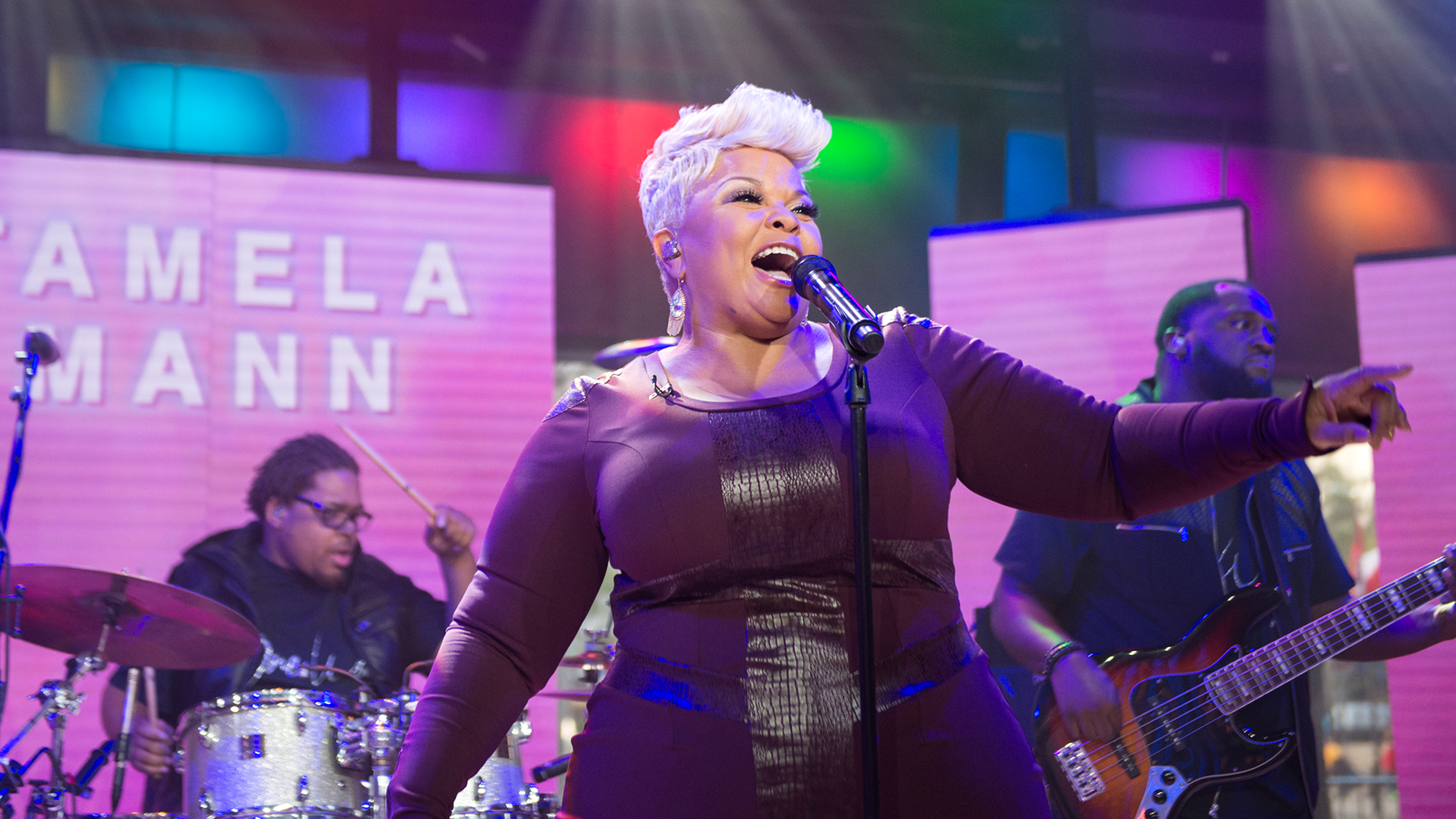 Tamela Mann was vibrant in champagne sparkles.