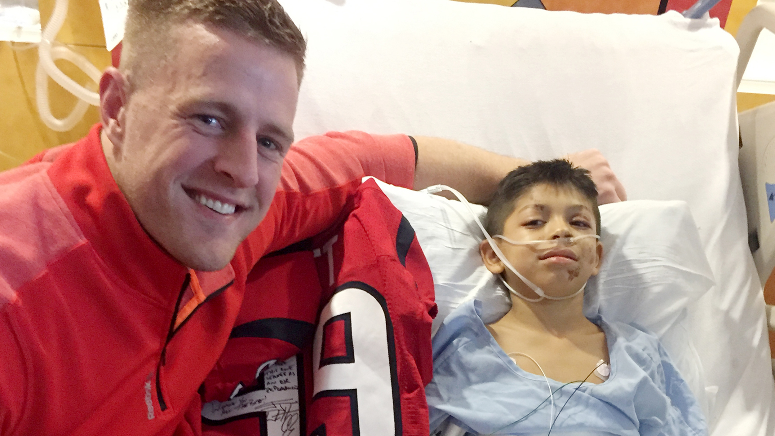 Texans J J Watt Delivers Football Jerseys To Injured Boy