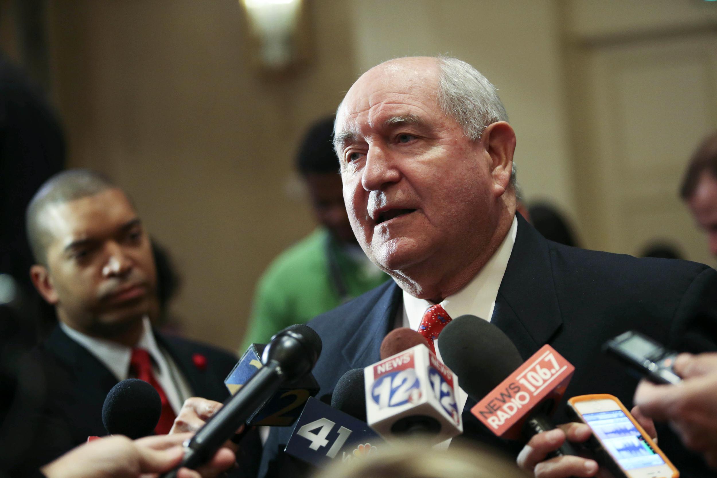 Image: Former Georgia Gov. Sonny Perdue talks with members of the media on Nov. 4, 2014 in Atlanta, Georgia.
