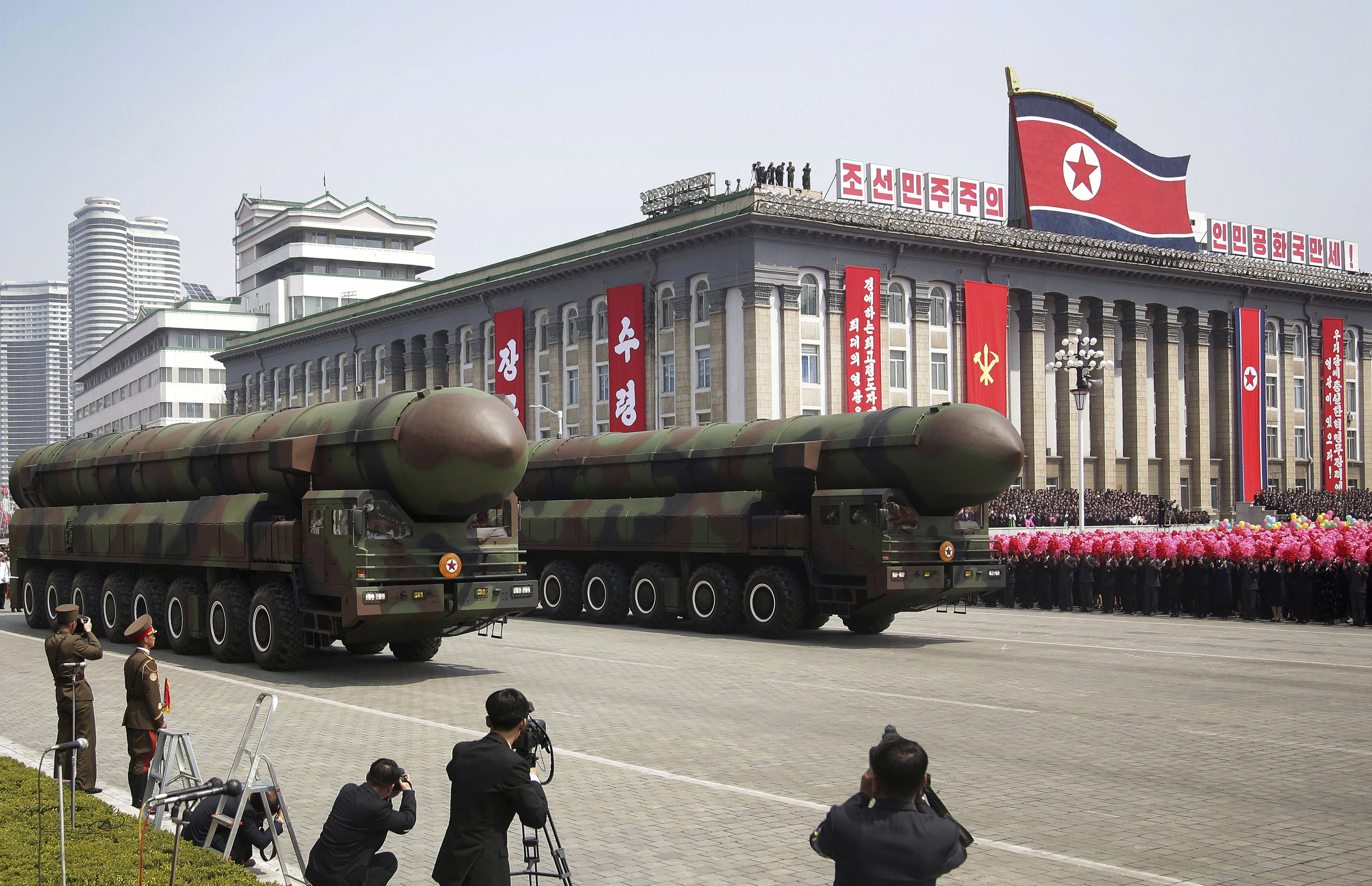 Image: Missiles are paraded across Kim Il Sung Square during a military parade