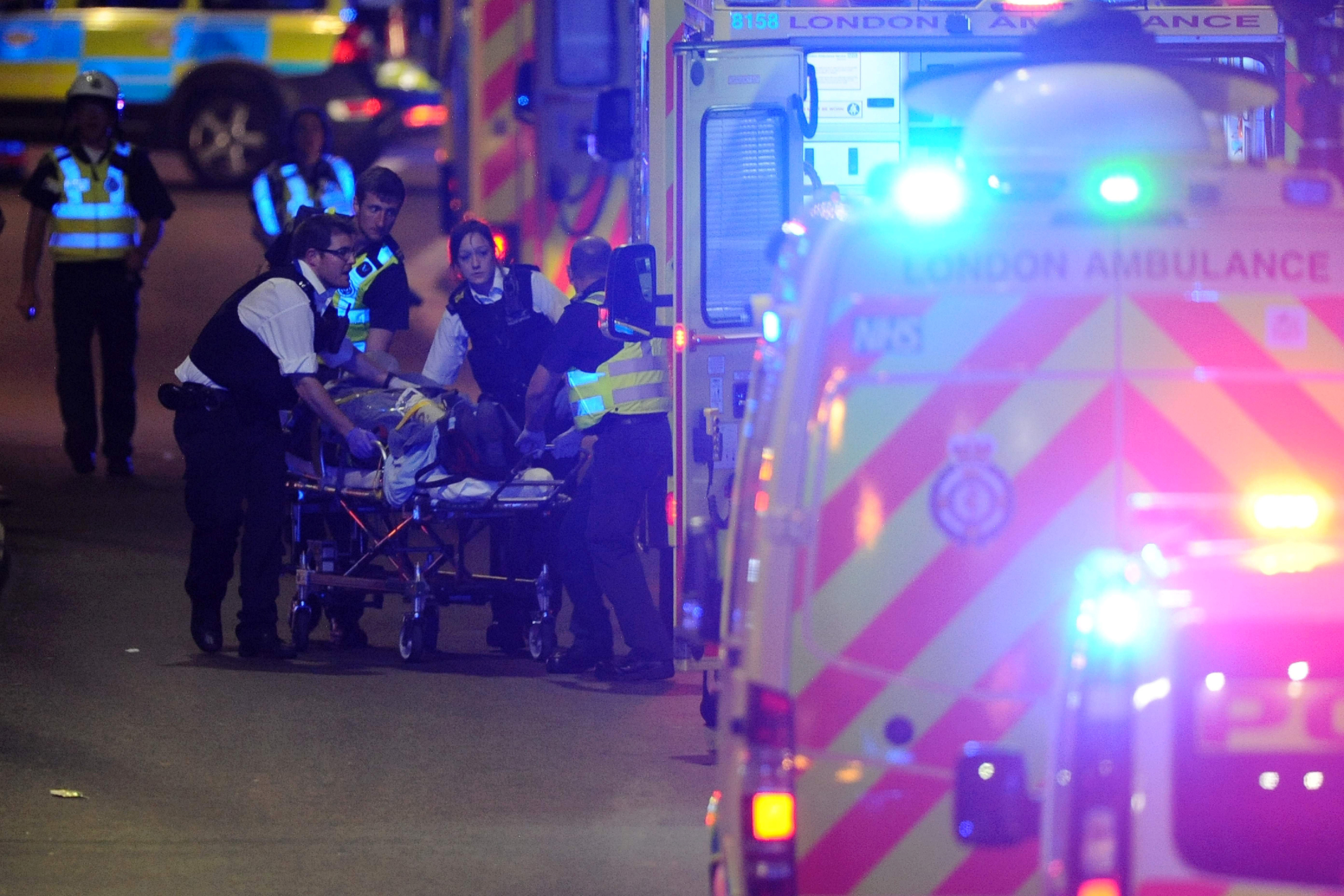 Image: Police officers and members of emergency services attend to a person injured in an apparent terror attack on London Bridge in central London on June 3, 2017.