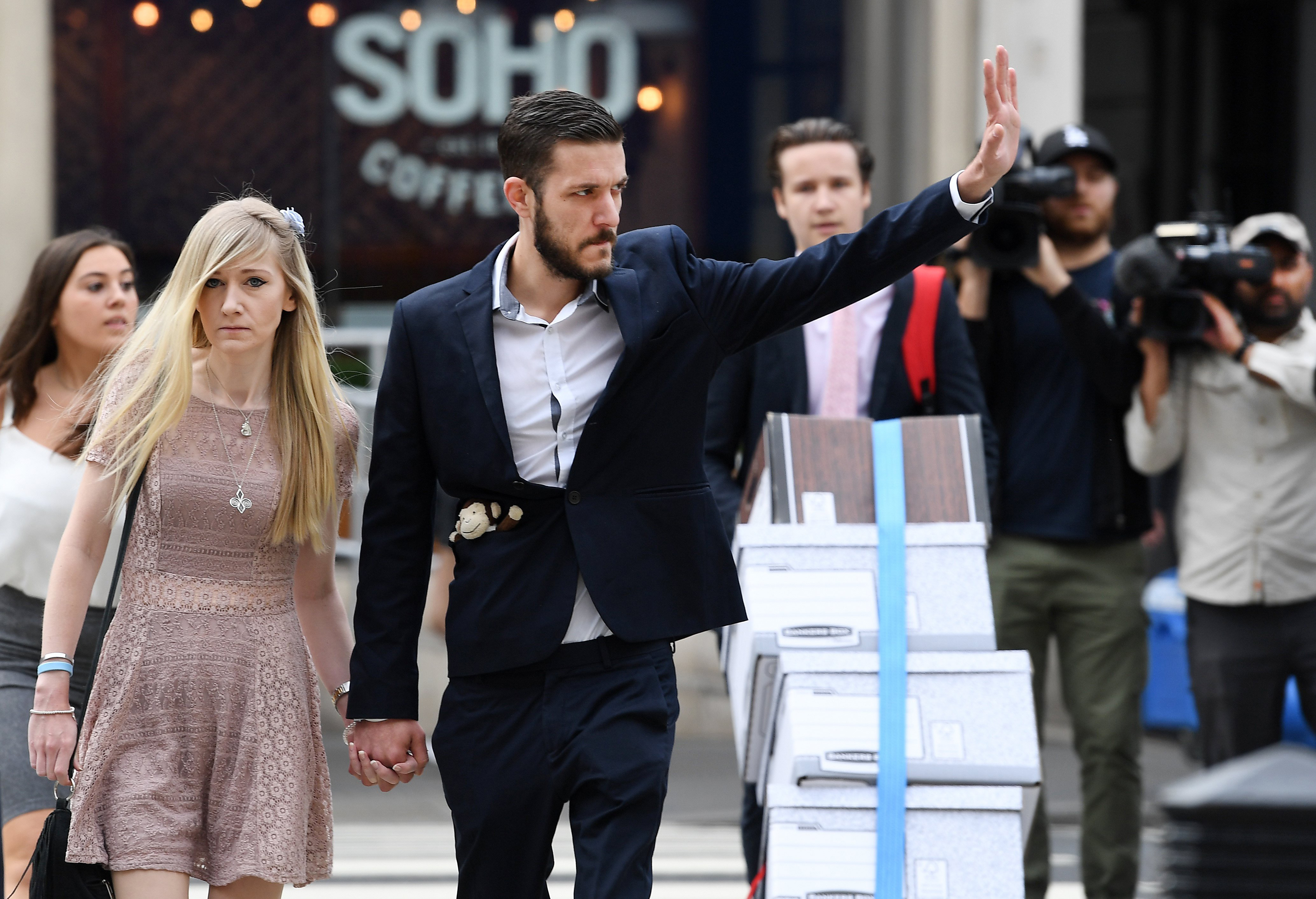 Image: The parents of Charlie Gard, Connie Yates and Chris Gard, arrive at the High Court with a spokesperson in London