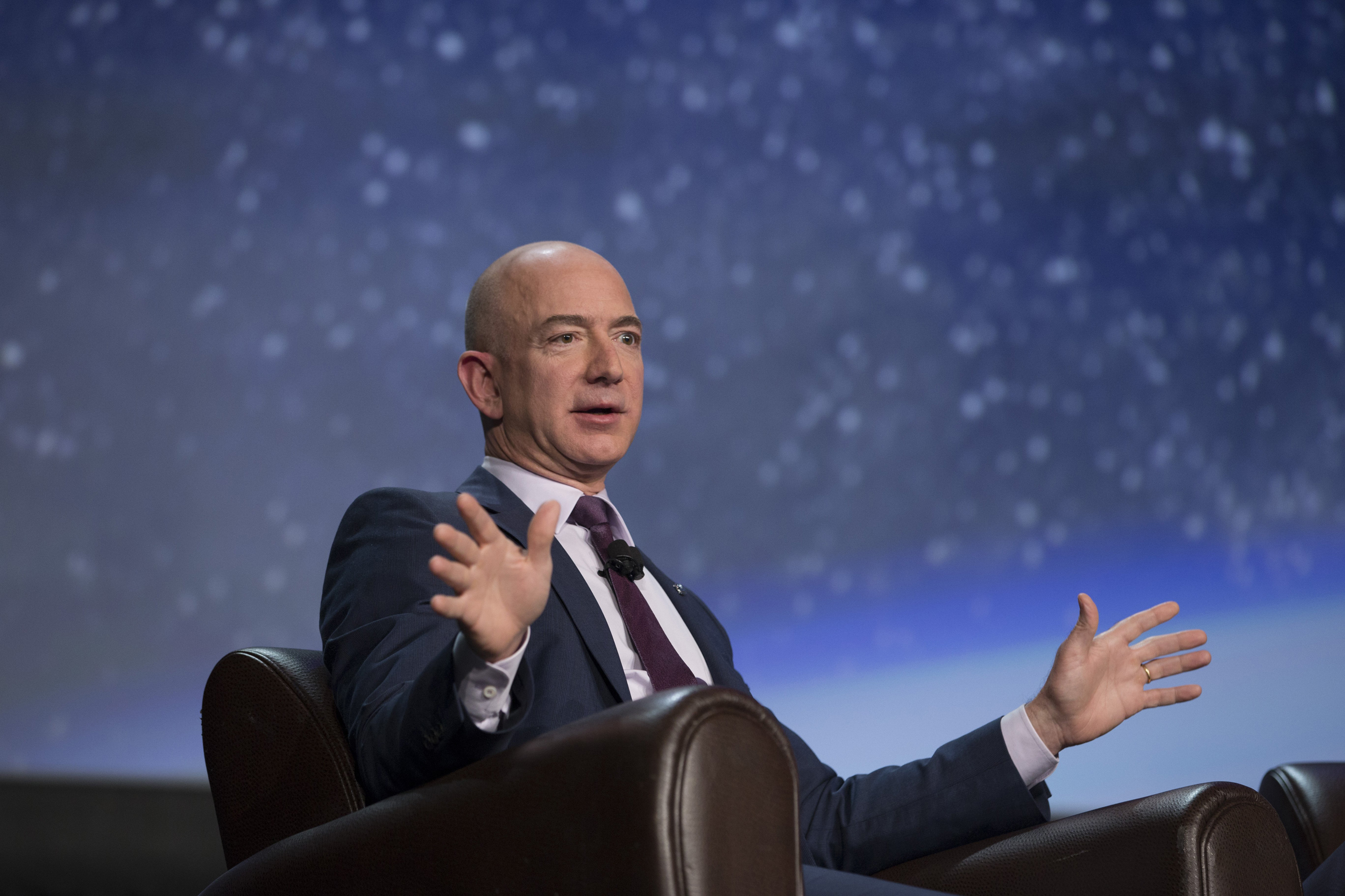 Image: Jeff Bezos speaks during the 32nd Space Symposium
