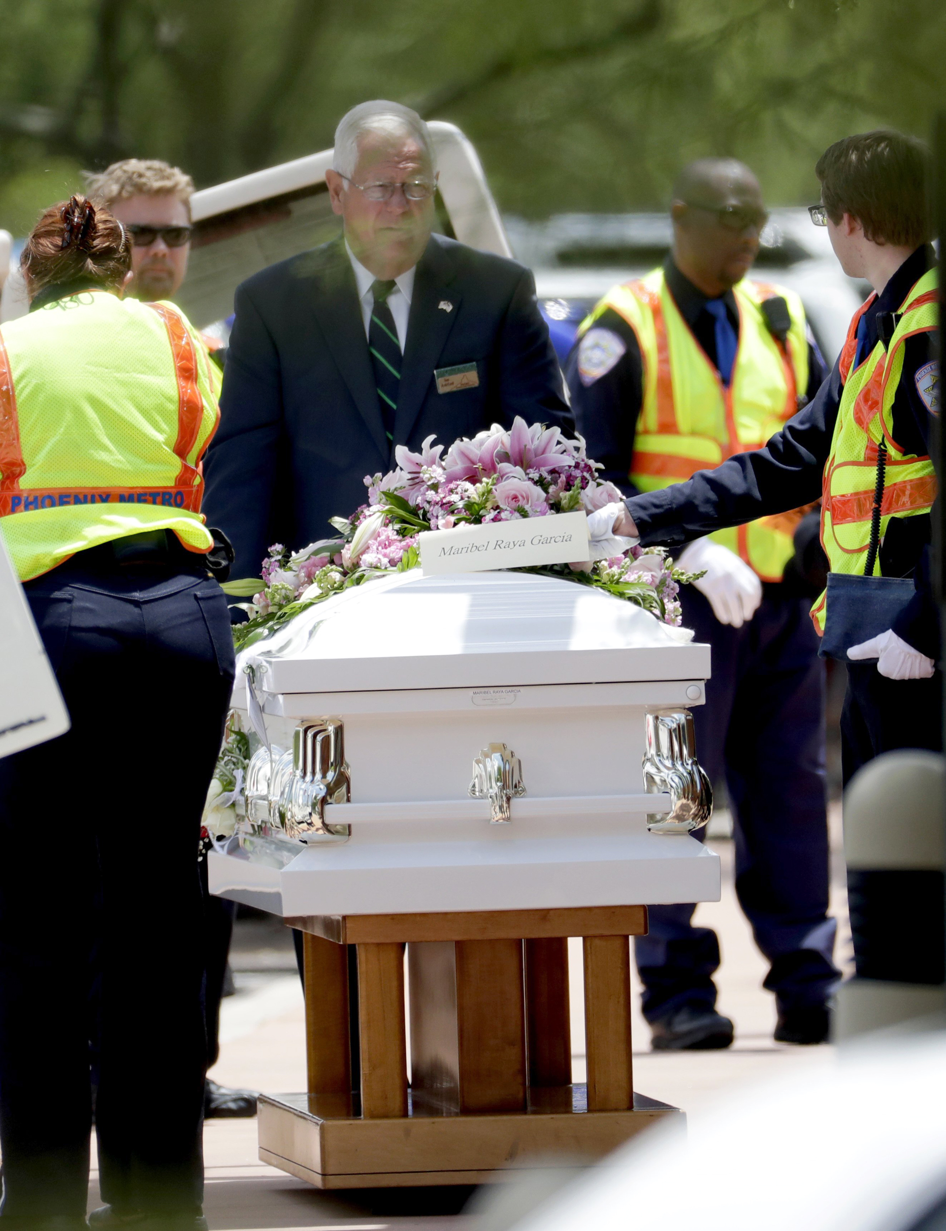 10 White Caskets And Memories Funeral Honors Flood Victims