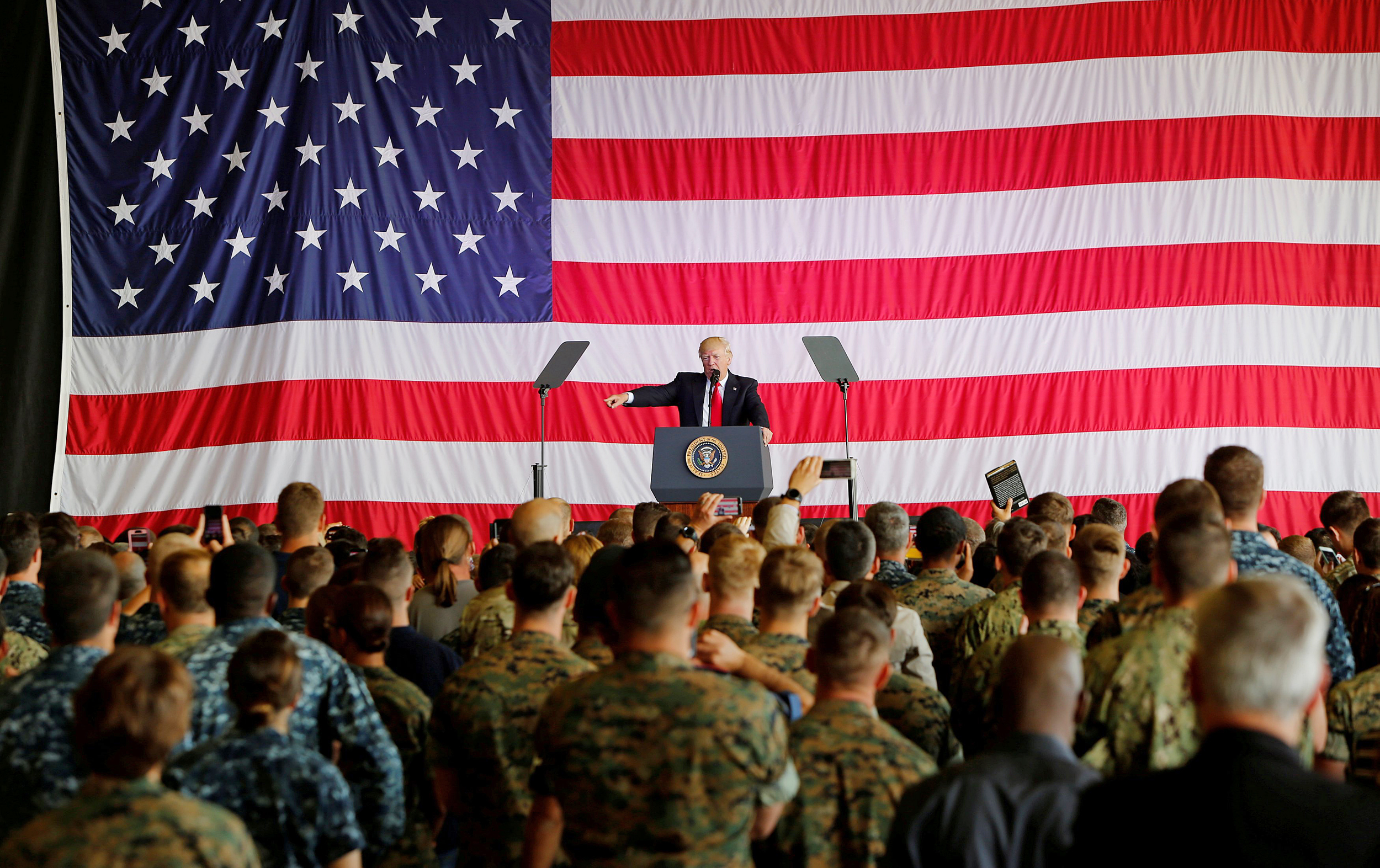 Image: U.S. President Donald Trump delivers remarks to U.S. military personnel at Naval Air Station Sigonella following the G7 Summit, in Sigonella