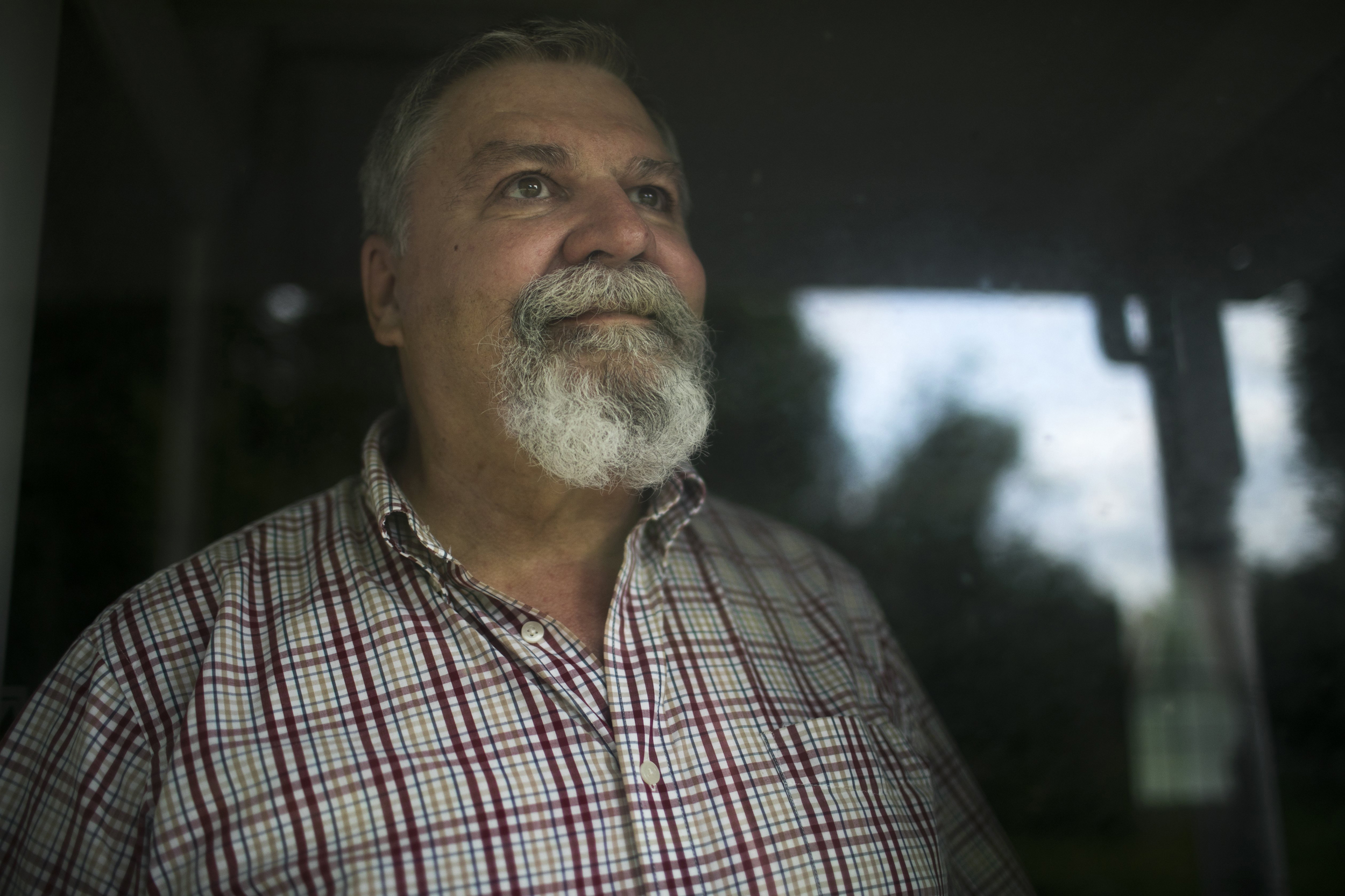 Image: Larry Harmon stands in his home in Kent, Ohio, on Aug. 4, 2017. Harmon was removed from the voting rolls after not voting in the last election.