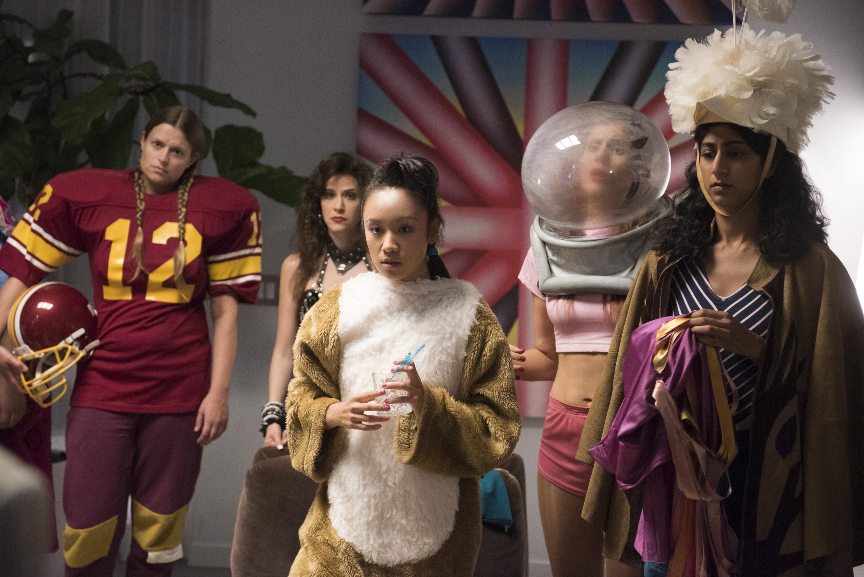Image: Ellen Wong (center) plays Jenny Chey on Netflix's