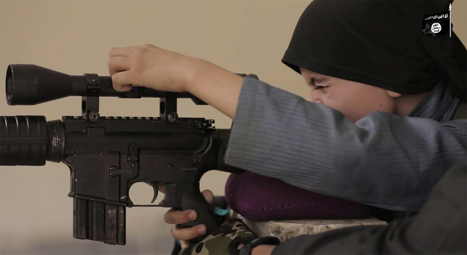 Image: A child who indicated that his name is Yousef, 10 years old speaks in an ISIS video titled