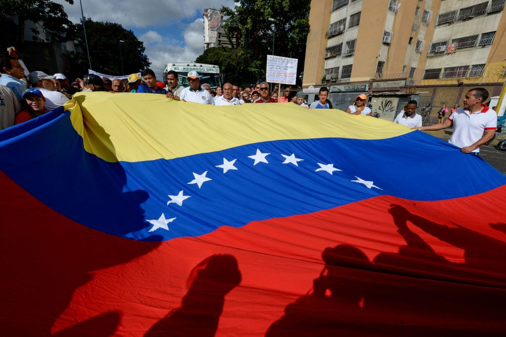 Health care workers holding Venezuela's national flag demonstrate against President Nicolas Maduro's government, in Caracas on February 7, 2017.