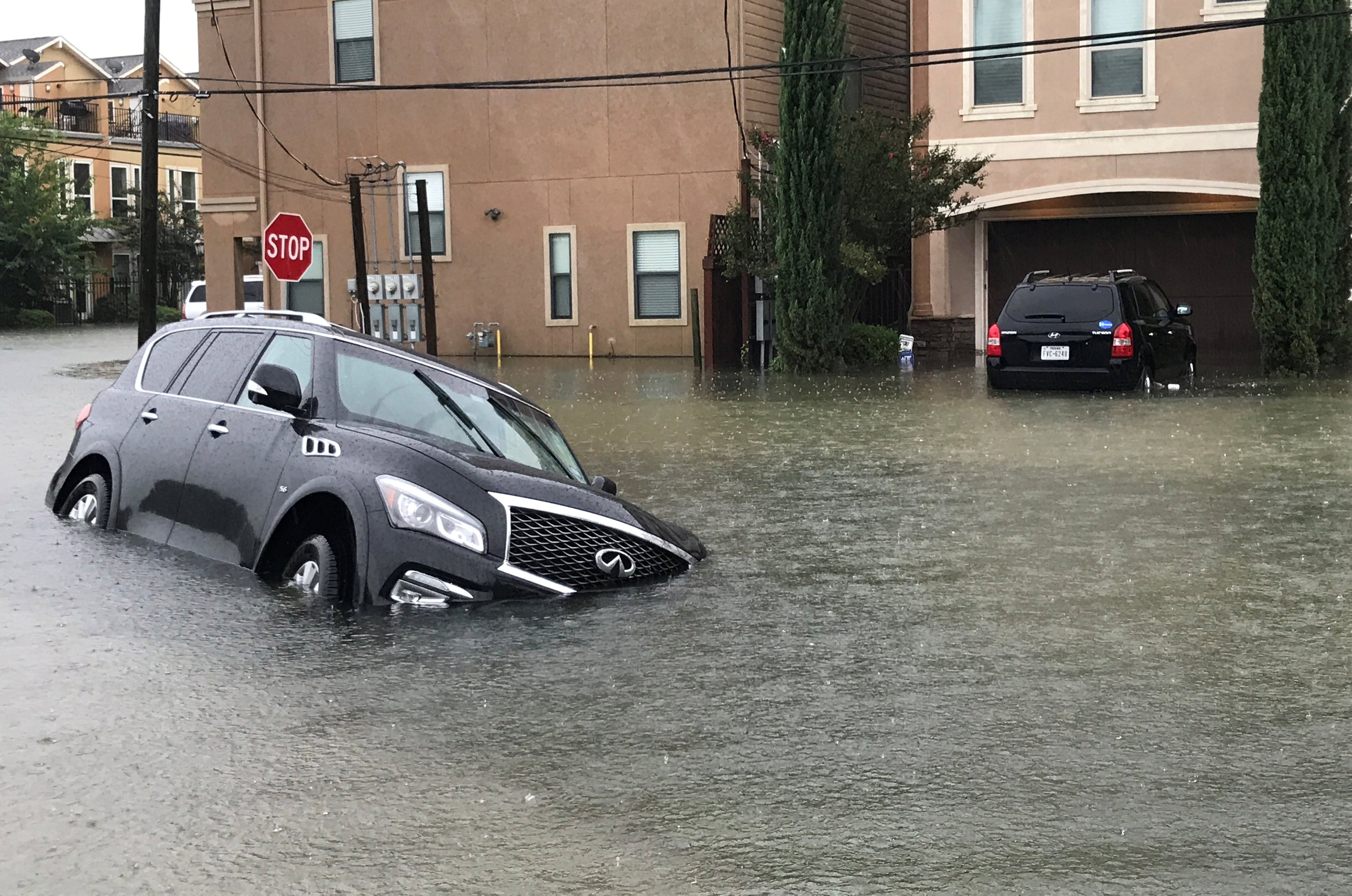 Image: A vehicle sits half submerged in flood waters in a residential area in the aftermath of Hurricane Harvey in Houston