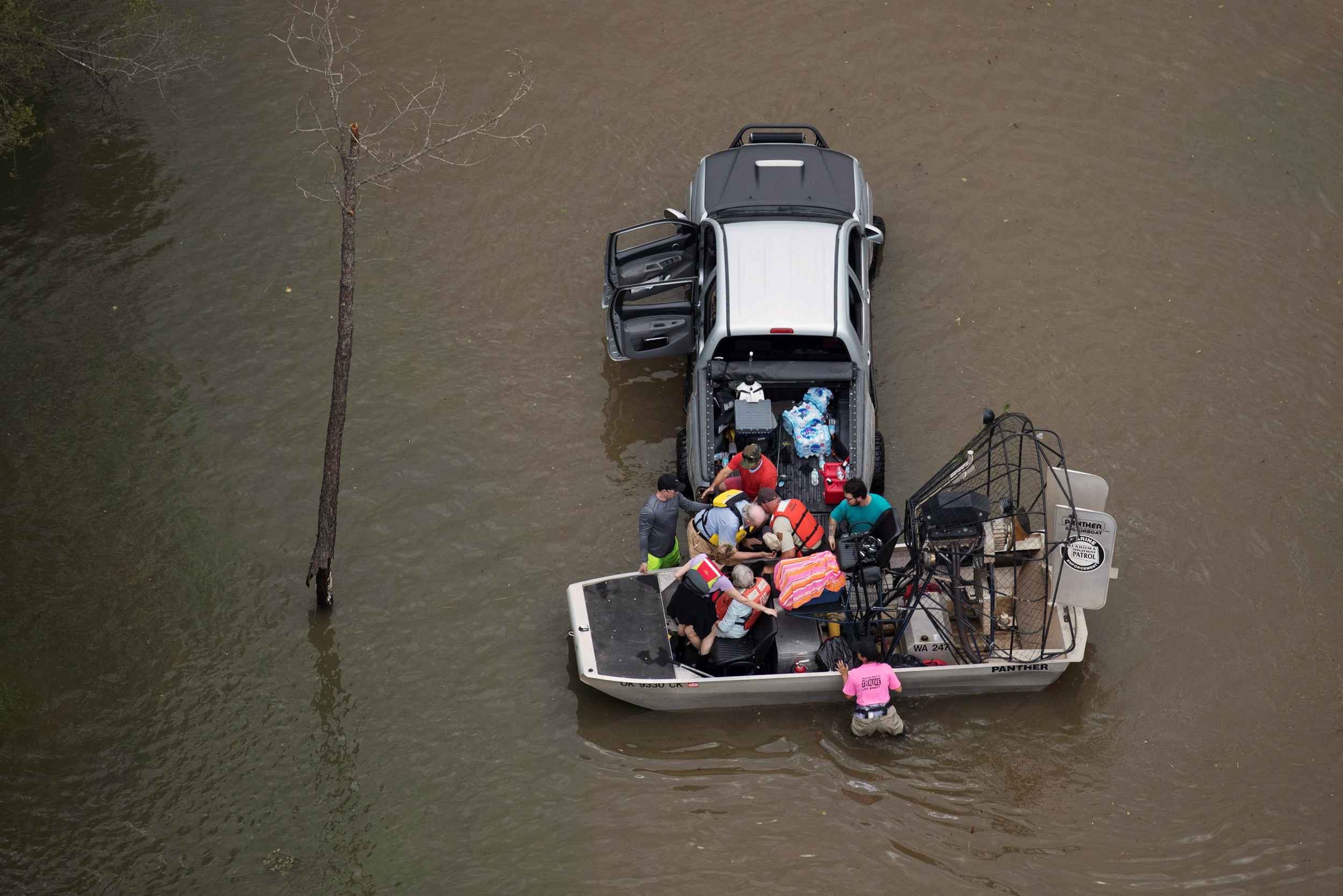 Image: Residents are evacuated through flood waters caused by Tropical Storm Harvey in West Houston, Texas