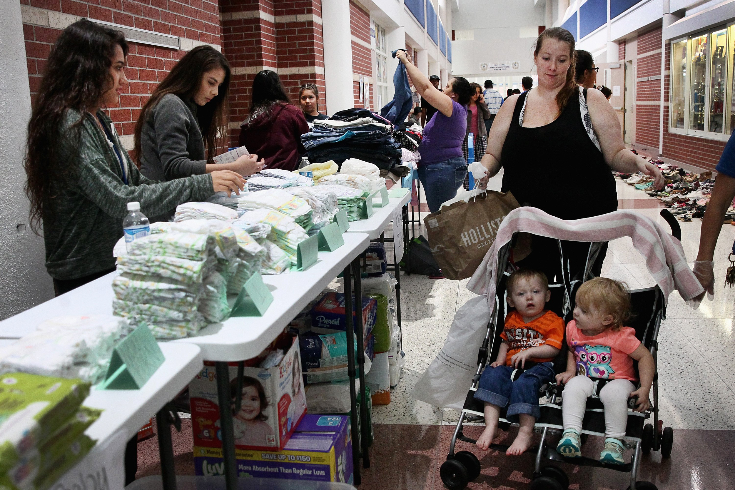 Image: A woman looks for items for her two children