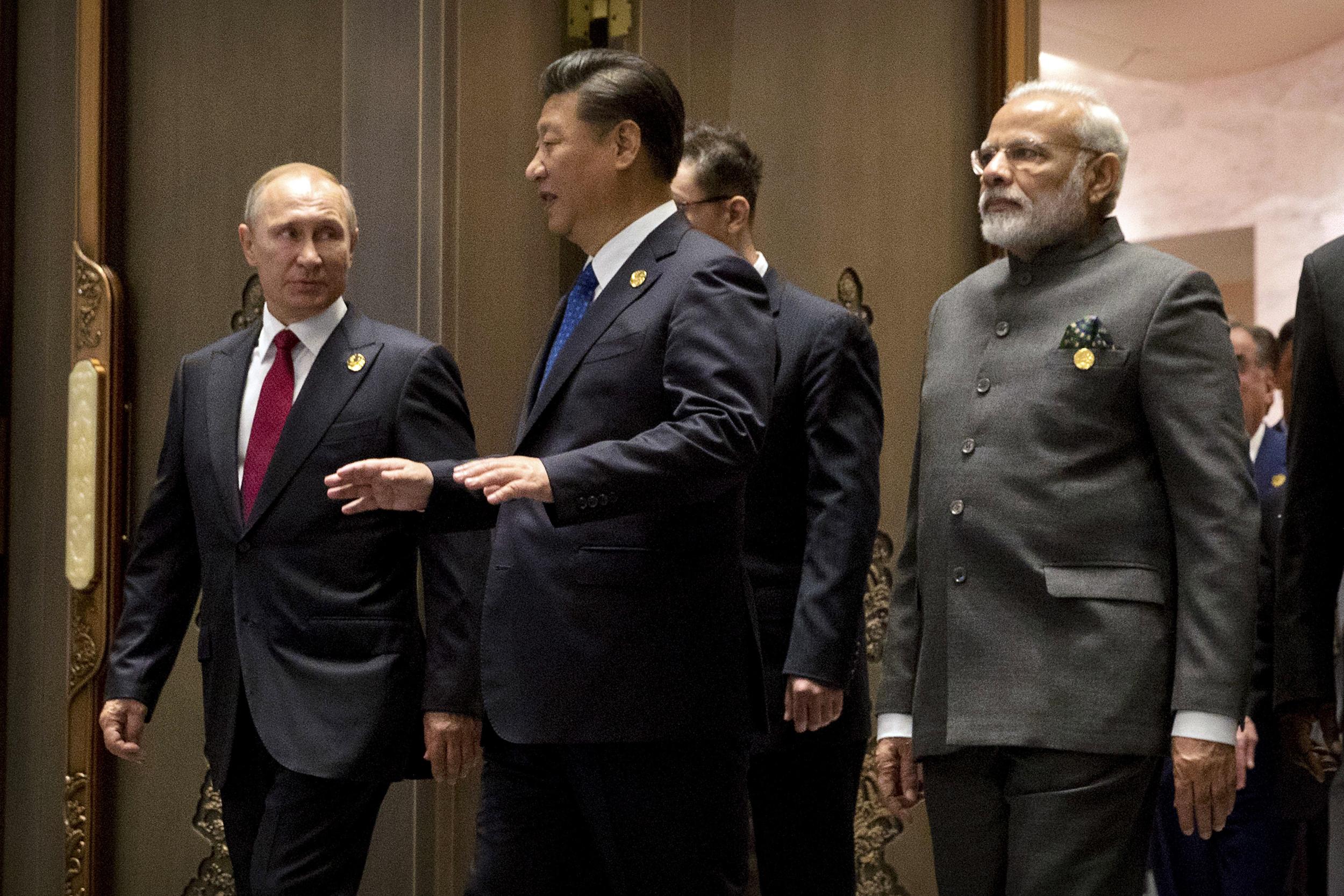 Image: Russian President Vladimir Putin, Chinese President Xi Jinping and Indian Prime Minister Narendra Modi