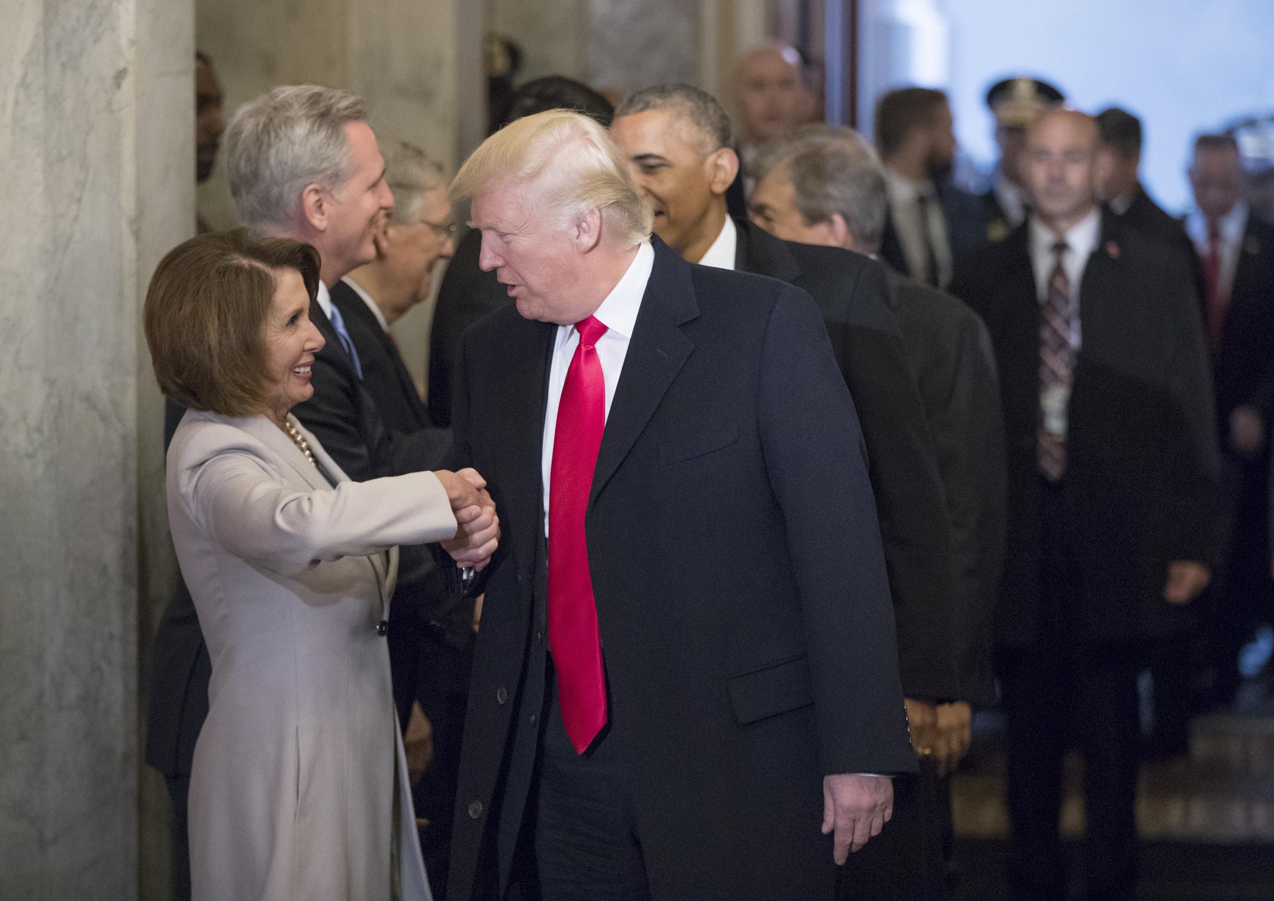 Image: President-elect Donald Trump greets House Minority Leader Nancy Pelosi