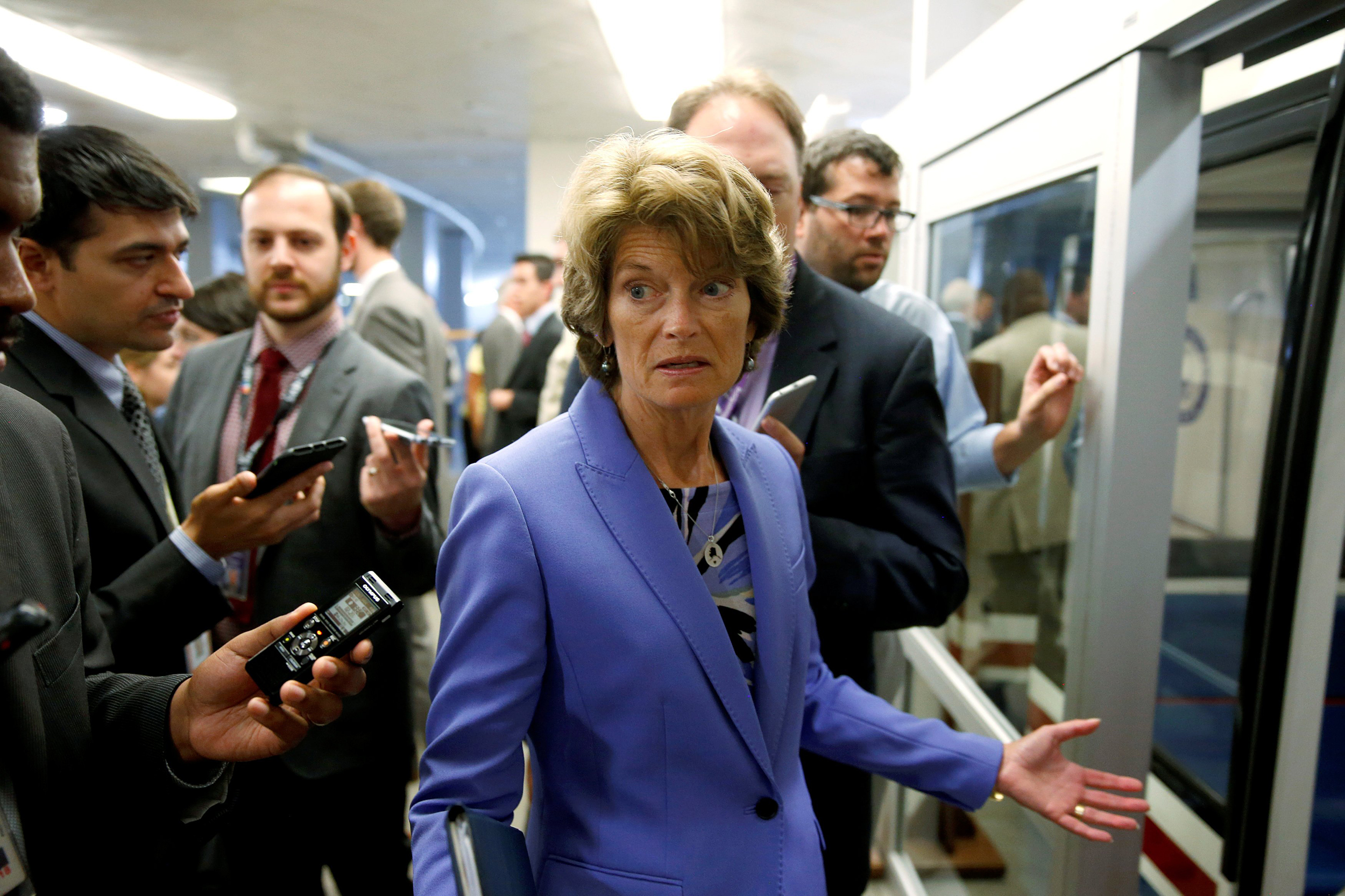 Image: Senator Lisa Murkowski (R-AK) speaks to reporters after the Senate approved $15.25 billion in aid for areas affected by Hurricane Harvey in Washington